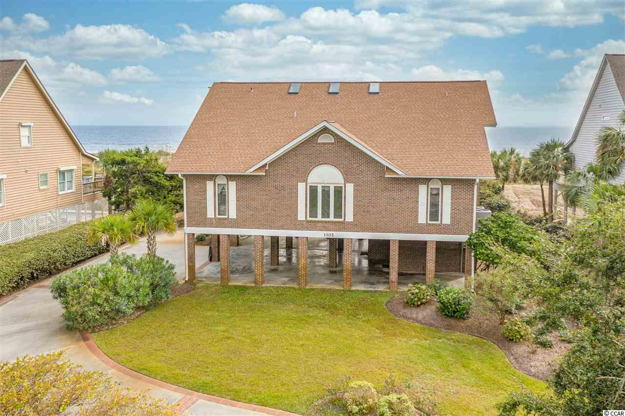 One of a kind all brick home on ocean front in Tilghman area with all the focus on the Grand Strand. Beautiful views from living area on every floor.   Two large living areas, including Carolina room on upper floor  along with two master suites combine to make this a fantastic home for a family to enjoy all year round. This home is in immaculate condition with nothing left undone. Besides 5 bedrooms and 4 baths, there is a wall bed for the grandchildren installed in the loft area at the top of the stairs.  List and dates of improvements can be found in Associated Docs along with Seller Disclosures.