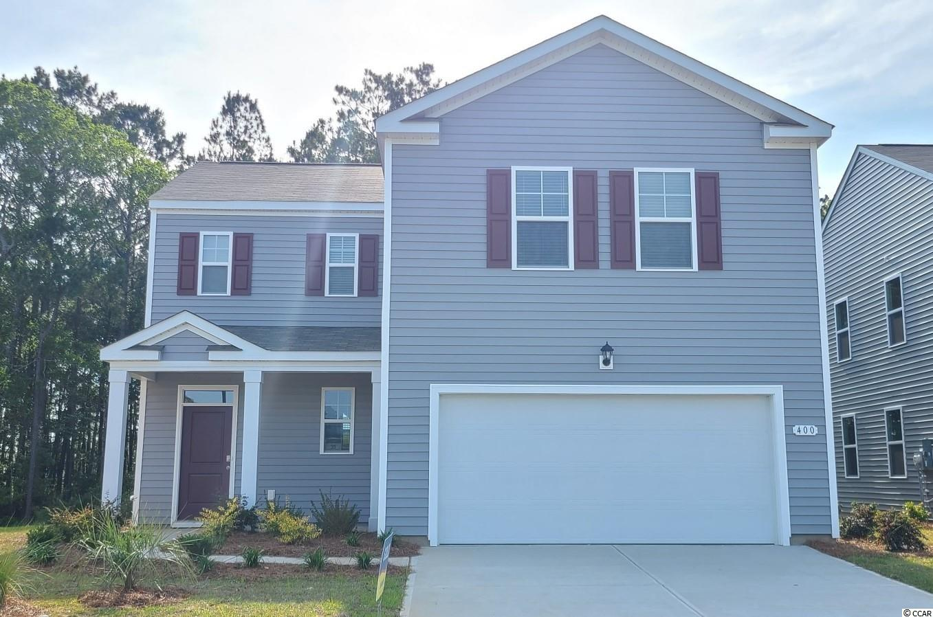 Oak Arbor is a brand new natural gas community conveniently located off of Highway 707 in Murrells Inlet close to shopping, schools, and the famous Murrells Inlet Marsh Walk. This Arden plan incorporates a smart design with thoughtful details that you will appreciate. The kitchen features an extra large pantry, a lot of cabinet space, granite countertops, and an efficient layout that is open to the dining and living room. Low maintenance laminate flooring throughout the entire first floor gives the look of wood with easy care and clean up! Sliding glass doors off the dining area lead to the rear covered porch creating a seamless transition from indoor to outdoor living. Upstairs, the primary bedroom is a perfect retreat with a walk-in closet and generous bathroom featuring a double vanity, large shower, and a separate linen closet. Plus, the laundry room is on the second floor with all of the bedrooms! Tankless gas water heater and a 2-car garage with garage door opener also included. It gets better- this is America's Smart Home! Ask an agent today about our industry leading smart home technology package that is included in each of our new homes.   *Photos are of a similar Arden home. (Home and community information, including pricing, included features, terms, availability and amenities, are subject to change prior to sale at any time without notice or obligation. Square footages are approximate. Pictures, photographs, colors, features, and sizes are for illustration purposes only and will vary from the homes as built. Equal housing opportunity builder.)