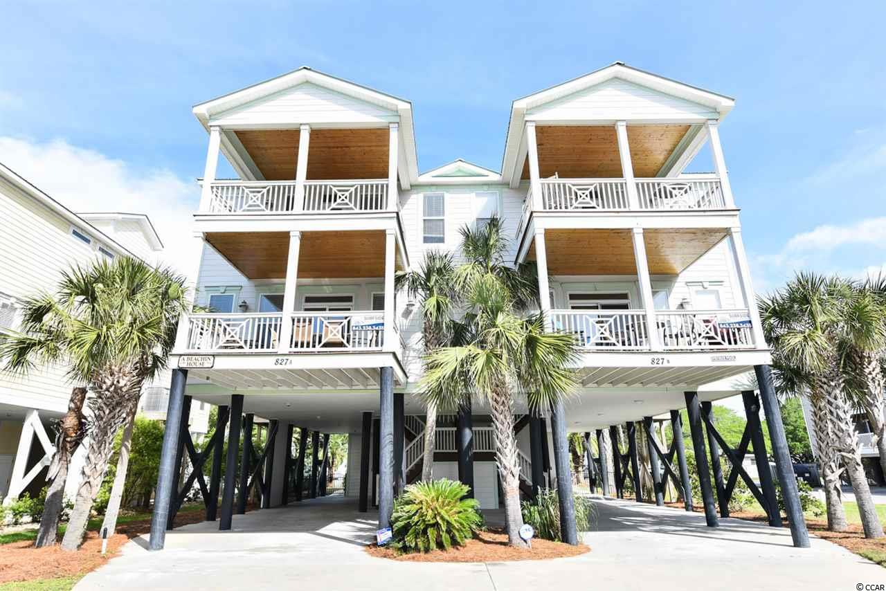 Take advantage of this remodeled 6 bedroom, 6.5 bath beach home with GREAT RENTAL INCOME and ocean views/bonus marsh views from the rear porch. This home has an elevator, hardwood floors in main area, new LVP in all the bedrooms, upgraded tile in the bathrooms, crown molding, the kitchen boasts granite countertops, stainless steelappliances. House comes fully furnished. Don't forget your private pool! This is a fantastic second row beach house.