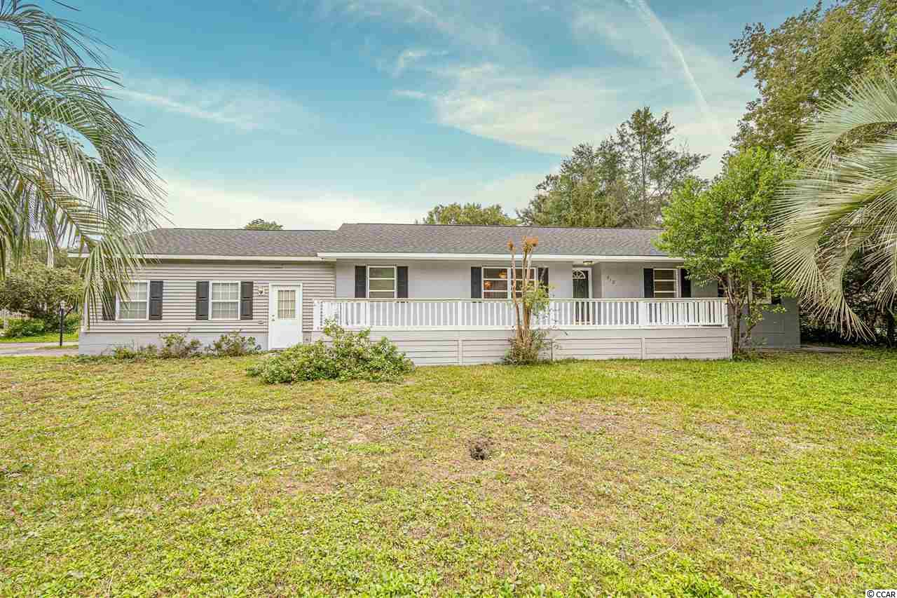 """Welcome to this wonderful home east of 17 in super popular Surfside Beach!  Located only about 3-4 blocks from the beach, this home just had a new roof installed in October 2020, and  the front deck was just painted too!  Three bedrooms, 2 baths, large GARAGE also comes with this fantastic home.  Nice corner lot with almost 1/4 acre of land!  Set your appointment to see this wonderful home in the heart of the """"Family Beach""""!"""