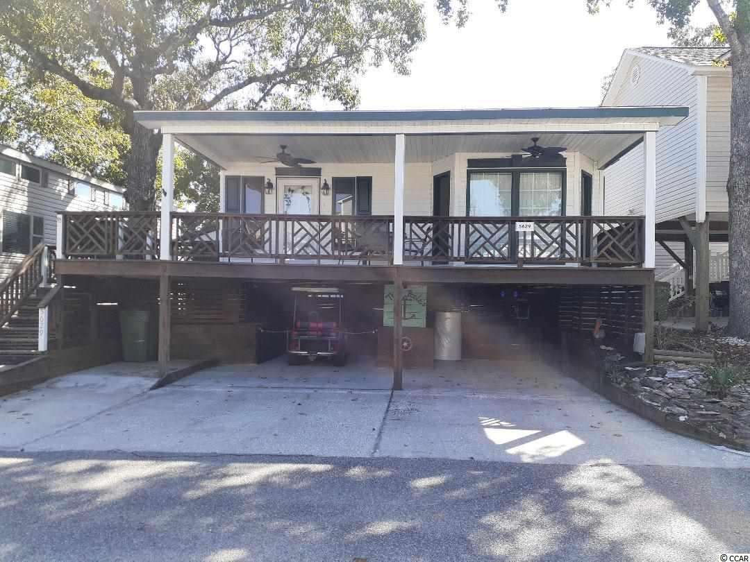 Clean & Bright 2BR/2BA raised beach home, located within the prestigious and highly sought after Ocean Lakes Campground, named 2017 Best Mega Park of the Year!  This home is completely furnished with a large wrap-around porch, two ceiling fans, custom storm door, and detached storage shed.  There is plenty of parking under the house, wrapped hot water heater & washer dryer in shed.  2005 Golf Cart is negotiable.  The spacious living room has a vaulted ceiling, large sectional sofa with matching ottoman, large flat screen TV, area rug, and a hand-painted mural on the walls.  Kitchen has oak cabinets, refrigerator, stove, and microwave. Large island with small breakfast area on one end with 2 bar stools, large dining area off kitchen with glass table dinette set.  Wide plank laminate flooring in living room & kitchen, carpet in bedrooms, and ceramic tile in both baths.  Crown molding throughout the house, all blinds and widow treatments to convey.  Both bedrooms have access to a bathroom with single vanity, tub/shower with vinyl surround.  Both bedrooms have a small flat screen TV; master with queen bed & dresser, second bedroom with full bed & dresser.  Whole house attic fan plus pull down attic stairs for easy storage.  These items DO NOT convey: cookie jars on refrigerator, lighthouse statue in dining area, boat on living room wall, black rocking chair on porch, small lighthouse suncatcher in kitchen widow, their name sign & ship's wheel on lower level.  Golf Cart is NEGOTIABLE.  There are no HOA fees however there is an annual lease which covers your basic cable TV, garbage removal, security and access to all pools, water-park, 4 annual vehicle passes and all amenities that Ocean Lakes has to offer. Don't miss this opportunity to own a home along a pristine part of the beach. Easy golf cart access to shopping, restaurants, activities, and so much more.   Ocean Lakes is a 310 acre ocean front complex with 24 hour security, nearly a mile of oceanfront, Outdoor Pool, Sandy Harbor Water Park, Sandy Mart, Meet n' Eat. Come play Basketball, Shuffle Board, Horse Shoes, enjoy their award-winning Recreation program. The gated campground also features an RV Center with a store and repair technicians; Golf Car Sales, Service and Rentals; camper storage and 24/7 security patrol. The 310-acre park is open year round . Short term rentals are allowed in Ocean Lakes. Measurements are approximate and can be verified by buyers.
