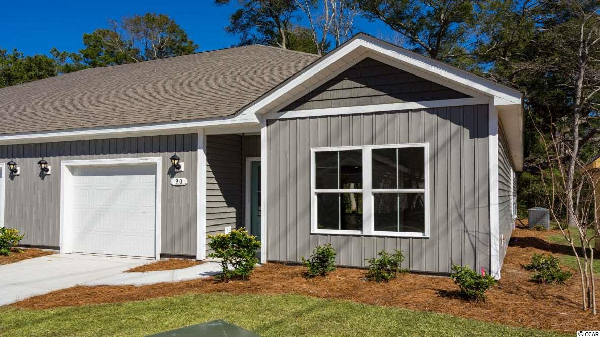 Brand new community within walking distance to the Murrells Inlet Marsh Walk! Low maintenance living at its best with these single level townhomes. This Bentley floorplan is an end unit and boasts an open concept kitchen, living, and dining area along with three spacious bedrooms! Features include modern gray painted cabinetry, granite counters in the kitchen, stainless Whirlpool appliances, and laminate wood flooring that flows throughout the main living areas. The primary bedroom suite has a walk-in closet along with a private bathroom with dual vanity and large shower. Enjoy the beautiful coastal weather on the rear covered porch! 1-car garage with garage door opener plus a spacious storage closet off the rear porch. It gets better- this is America's Smart Home! Ask an agent today about our industry leading smart home technology package that is included in each of our homes.  (Home and community information, including pricing, included features, terms, availability and amenities, are subject to change prior to sale at any time without notice or obligation. Square footages are approximate. Pictures, photographs, colors, features, and sizes are for illustration purposes only and will vary from the homes as built. Equal housing opportunity builder.)