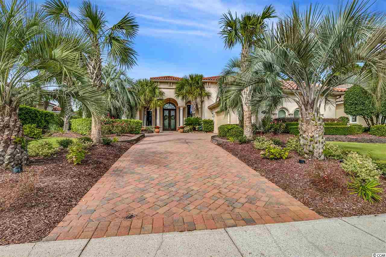 """Don't miss this amazing opportunity to own this Mediterranean masterpiece on the 1st hole in the highly exclusive gated community of Members Club at Grande Dunes. This 4 bed 4 full and 1 half bath home with a 3 car garage has some of the most beautiful landscaping in the entire community. This property is located in South Carolina's premier coastal community in Myrtle Beach. Grande Dunes stretches from the Ocean to the Carolina Bays Preserve, this 2200 acre development is amenity-rich and filled with lifestyle opportunities unrivaled in the market. Owners also enjoy the exquisite Ocean Club that has fine dining, oceanfront pools, meeting rooms and is truly a remarkable place for events. Amenities including two prestigious 18 hole golf courses. The Resort course is open to the public and the Nick Price designed """"Members Club"""" is open to members. Other features are a 126 wet slip deep water marina able to accommodate vessels up to 120 feet or more, and state of the art Har-Tru tennis facility. Grande Dunes is a wonderful and private community that sits conveniently in Myrtle Beach, close to shopping, dining and roughly a mile from Grand Strand Medical center. Come Live the Grande Dunes Lifestyle! Contact the listing agent for more information and to schedule a viewing."""