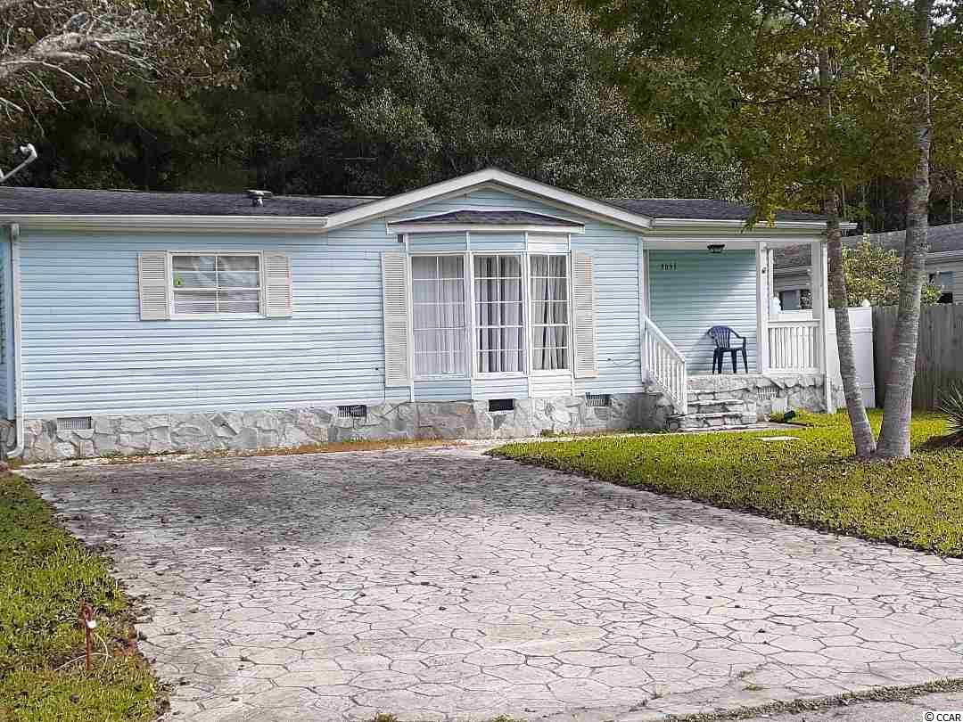 Affordable 2BR/2BA modular home in the lovely North Pointe subdivision.  You OWN the land.  This home has a spacious, vaulted great room with a bay window.  Large, eat-in kitchen with refrigerator, smooth-top stove, dishwasher, and microwave to convey.  Laundry room with full size washer/dryer to remain.  Storm windows throughout, except for bay window.  Carpet in great room and bedrooms; vinyl in kitchen and baths.  Master bedroom has a walk-in closet and ceiling fan.  Master bath has large garden tub, separate shower, and single vanity.  Second bedroom has two closets and access to hall bath.  Hall bath has a single vanity, and tub/shower surround. Large, fenced backyard with small patio, concrete driveway, maintenance -free vinyl siding, and small front porch.  This community is conveniently located 3 miles from the ocean and Cherry Grove Beach and close to Hwy. 9 and Hwy. 31.  It is convenient to North Myrtle Beach, Barefoot Landing, and many other dining, shopping, and entertainment choices.  A great place to retire or have a second home!