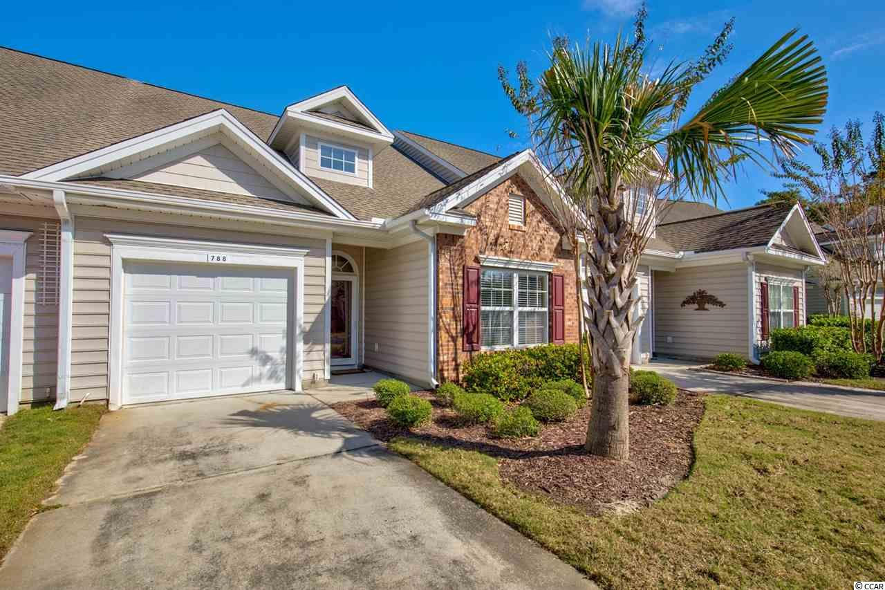 This 2 bed, 2 bath lake view townhome can be yours in the sought after Prince Creek gated community. This premium lot has a large kitchen/dining room combo and is open to the living area with vaulted ceilings in the living room and master bedroom. Have breakfast in the Carolina room while enjoying the lake view with it's abundance of wildlife. Large master bedroom with master bath and walk-in closet. John's Bay residents gain access to their own pool and weight room in addition to all the other Bays' amenities: two pools, clubhouse w/ exercise room, tennis, pickle ball, volleyball, basketball & bocce ball courts. Gather with friends and family at the outside pavilion w/fireplace, kitchen & picnic area. You can bike or walk to the grocery stores and restaurants. Garden City beach 4 miles away, and Huntington Beach State Park 10 miles.