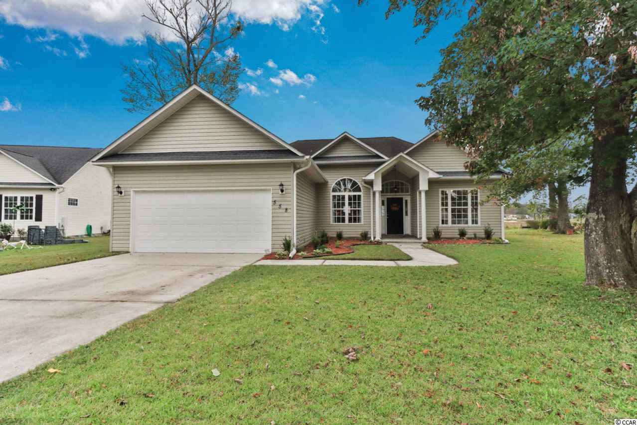 This beautiful 3 bedroom, 2 bath house, located in the established and desirable community of Deerfield Plantation, is designed for carefree living just a quick golf cart ride to the beach. It has a split bedroom floor-plan and a large living room flooded with natural light and a nice fireplace. The kitchen has plenty of cabinet space, stainless appliances, and a tile backsplash. The breakfast nook has several windows and is open up to the main living areas. The Master suite is spacious! The Master bathroom has a beautiful tiled shower and whirlpool tub! Come make this home your own! You have the space and yard to make it absolutely perfect!
