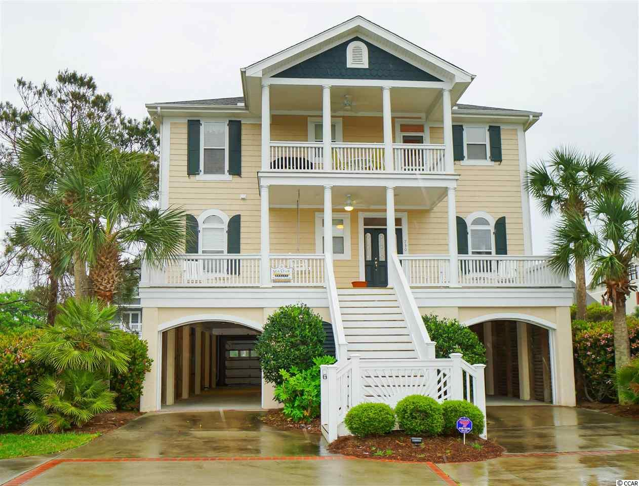 This 6-bedroom, 6.5-bathroom home is situated on a huge ocean view lot in the very desirable North Litchfield Beach community.  Easy beach access just across the street, only a few steps away.  The inverted floor plan, expansive screened porches and rooftop crows nest maximizes ocean views from this home.  Features include six ensuite bedrooms, hardwood floors, crown molding, wainscoting, tray ceiling, elevator, wet-bar, fireplace, 5 porches, and much more.  Recent updates: 2016 - new HVAC units, 2019 -exterior painted, new ice maker at wet bar and new refrigerator.  Being sold fully furnished.  Currently used as a second home and income producing vacation rental.  Covered and driveway parking for 6+ vehicles as well as a boat.  Large lot that should allow plenty of room to accommodate a pool addition.