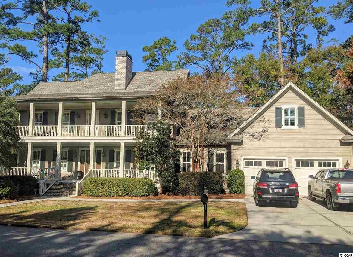 What an amazing home in one of the most coveted neighborhoods in Pawleys Island. Litchfield Plantation is known for its gorgeous Spanish moss laden live oaks, rich history and mature landscape. This well appointed 5 bedroom 5.5 bath is perfectly situated on a corner lot. Each room has a full bath and the large guest suite complete with a living room and secondary entertainment room has a private entrance from the exterior of the home. Litchfield Plantation has great amenities that include a stunning pool overlooking the Waccamaw River Marsh, guard/gate, and the use of a private beach house on Pawleys Island. This will not last long.