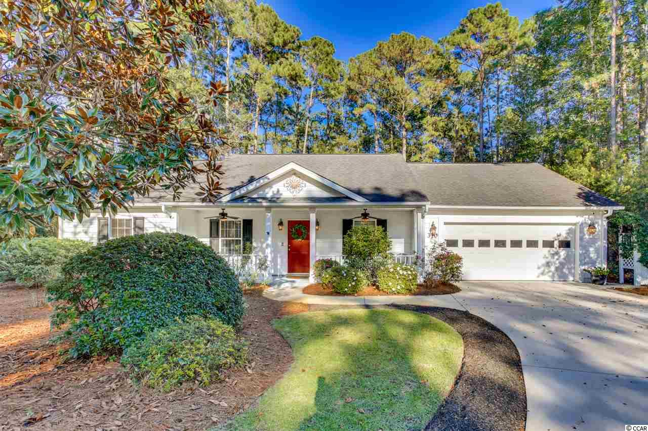 Caution viewing may cause ...strong desire to buy home!!  Nestled in the heart of Hagley Estates, close to the beach and even closer to the Waccamaw river is a Pawleys Island home that sits on a large shady lot. The lot is overlooking the Founders Golf Course,  yet feels very private. Bright and cheery atmosphere from the time you pull in the driveway.  This 3 bedroom, 2 bath Ranch is a meticulous!  Unique light fixtures and ceiling fans throughout.  Split bedroom plan with two bedrooms on one side, and Master suite on the other. Entertain easily, either inside or outside.  Gather around the fireplace during football season and holidays  or make use of the wide open deck while you barbecue.  One of my favorite additions is the outside heated shower so that after a day at the beach, rinse off outside and leave the sand outside!   Voluntary HOA, and a relaxed community where you can keep your boat or RV on your own property! Close to all that Pawleys has to offer, fishing, crabbing, swimming, boating shopping or dining or even pickle ball at the local rec center!    Not too far from Charleston for a day trip! Don't blink because this house may just be sold soon!.