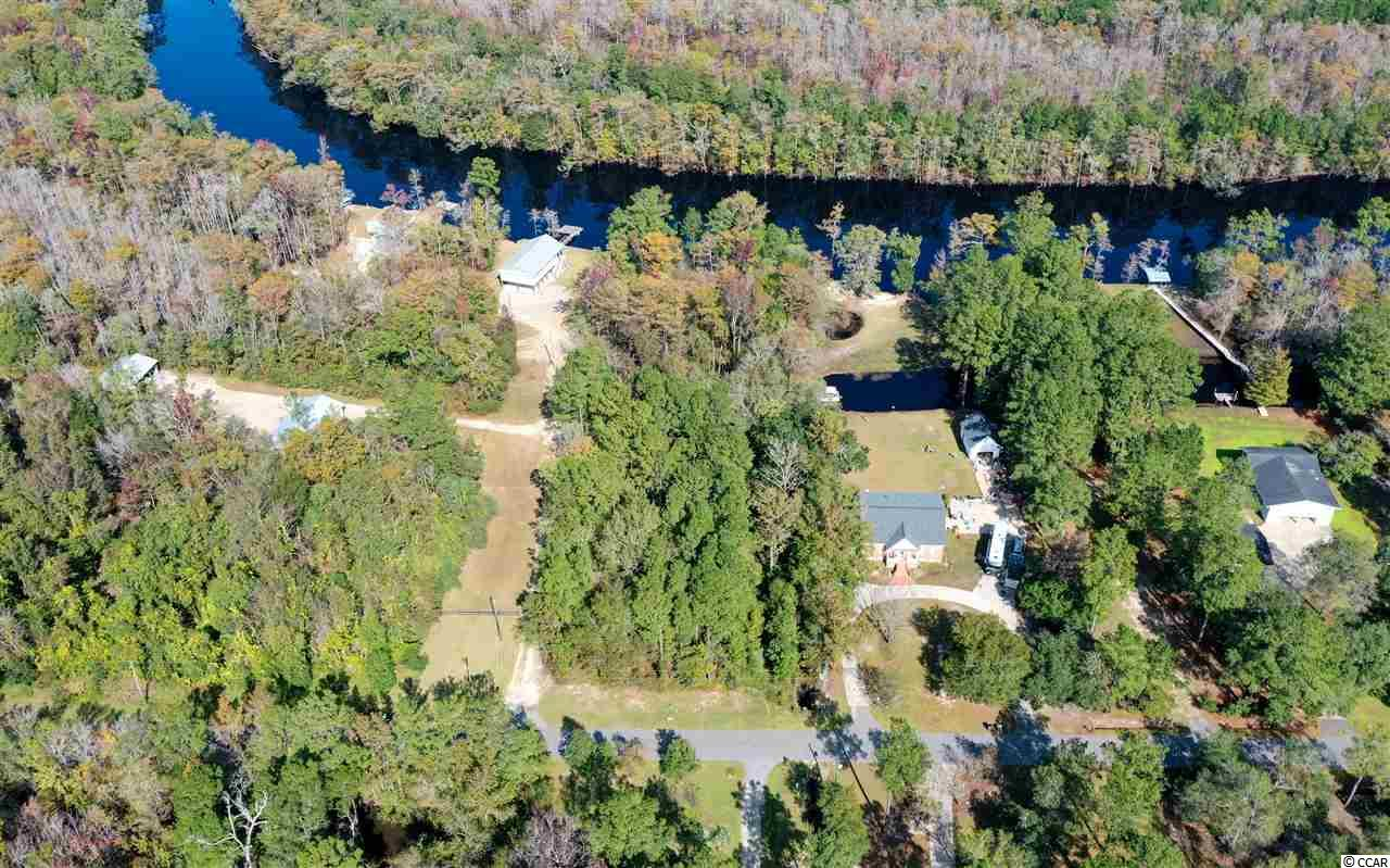 This beautiful wooded lot is located on the Waccamaw River with direct access to the Inter-Coastal Waterway. This would be the perfect location to build a custom home and boat dock. Very quite neighborhood, perfect for privacy and relaxation. Be sure to check out the virtual tour of this property to see a aerial 360° view of this property and the surrounding areas.
