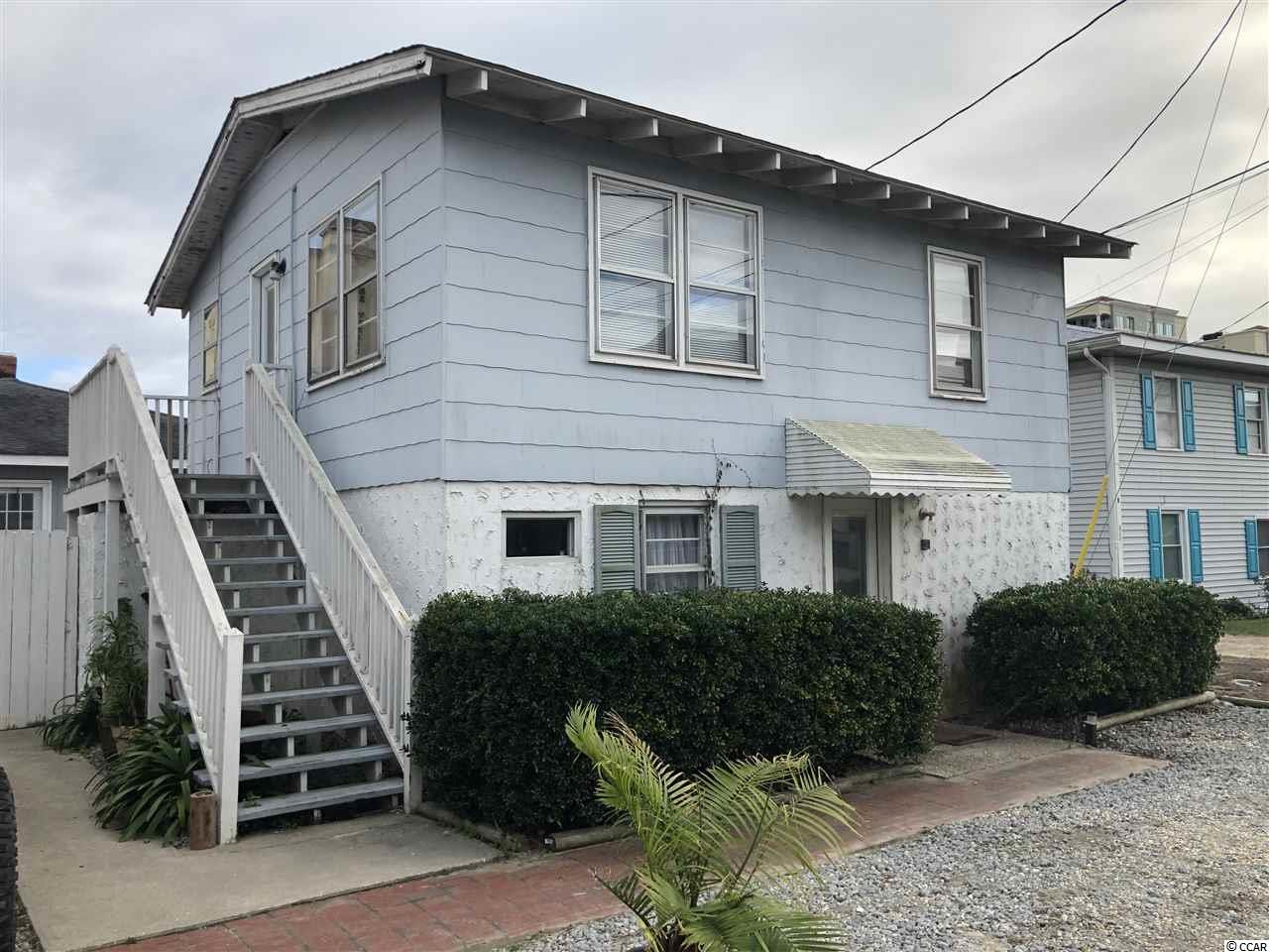 Check out this fully leased income producing triplex in the heart of North Myrtle Beach just a stones throw from the beach.  The street to street lot is located between Hillside Dr and Miller St in Ocean Drive.   There are 2 structures....the Hillside Dr structure is a 2 story, 2 bedroom home.  Theres a large living room, kitchen and bathroom downstairs, and 2 spacious bedrooms and a full bath upstairs.  The Miller St structure is a single story home with 2 dwellings.  Each dwelling features 2 bedrooms and 1 full bath.  There is a shared courtyard with lots of privacy and charm.  This property would be perfect for short term, weekly rentals or long term annual rentals.   This is the perfect location, being only one block from the beach and just a few shorts block from Main St and all the area has to offer.