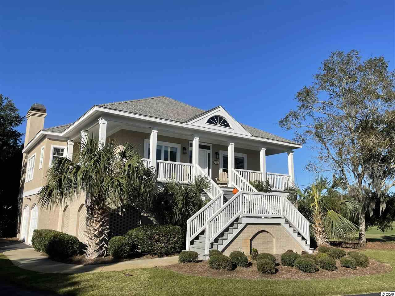 """Located in the one of the most exquisite gated communities on the coast of South Carolina, Debordieu Colony. Debordieu is located between Charleston and Myrtle Beach, just south of Pawleys Island. This Fairway Oaks free standing golf villa is just a short golf cart ride to the beautiful secluded beach. The raised beach style, 3 bedroom, 3 bath villa, all one level living offers an open floor plan with spectacular, panoramic views of Debordieu's Pete Dye private golf course from the spacious family room, dining room, screened porch, laundry and  kitchen! Recent upgrades throughout the home are a plus. In 2017, luxury vinyl plank flooring, all interior walls/trim painted, new granite in kitchen, new hardware on doors,  new interior and exterior light fixtures and roller shades.  In 2019, new kitchen stainless steel appliances, installed new gas logs in fireplace, new hot water heater and rescreened porch.  There is 2150 approx heated sqft of living with plenty of parking for your cars, boat, and golf cart all underneath with additional ample storage with optional lock-out space for rental flexibility. The Fairway Oaks community pool is steps away from the villa. Fairway Oaks monthly fee includes cable/internet, twice per week trash service, and all exterior grounds and building maintenance.  In addition, there is a boat landing access to North Inlet and the Atlantic, a 24 hour manned security gate, private Pete Dye golf course, a tennis & fitness center and an oceanfront Beach Club with dining, a ocean front gazebo bar, pool and playground. You may just say... """"There is truly no place like a home in Debordieu!"""""""