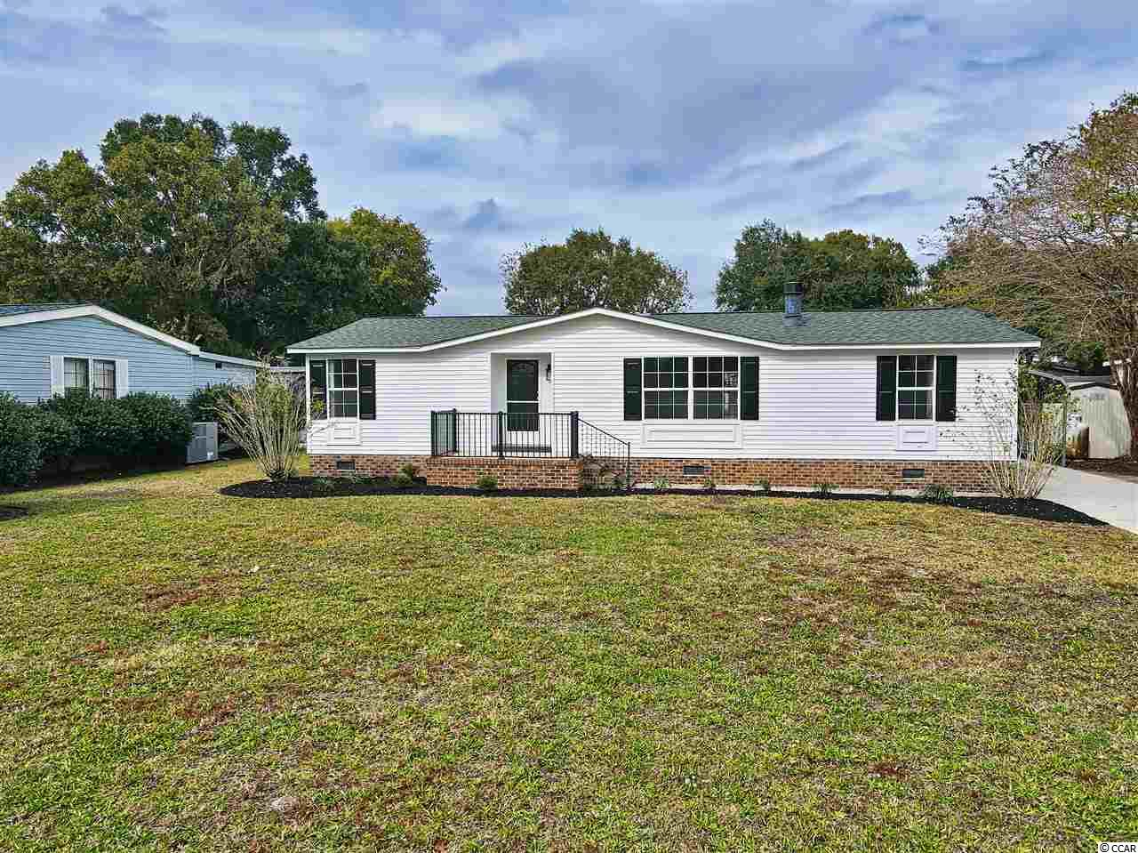 Wonderfully fully renovated home in the highly sought after Murrells Inlet! This is an unbelievable home, in an incredible location right next to the Waccamaw Hospital and only 5 minutes from the famous Murrells Inlet Marshwalk. Best part about it all, NO HOA! Perfect for parking your trailer, travel trailer, boats, RV, jet ski's and all the toys! There is also a shed for storage. This lovely double wide home with a brick foundation sits on a large lot with a concrete driveway that leads up to a carport. if you are looking for something completely turn-key, then look no further! Spacious kitchen with granite counter tops, new flooring and paint throughout, new stainless steel appliances, this home is like a brand new home, but at a price you can afford. Plenty of parking, including a carport, and an over sized screened in patio that also has a covered non-screed section as well. This truly is the home you have been searching for! Call the list agent or your realtor today to schedule a showing before this one is gone!