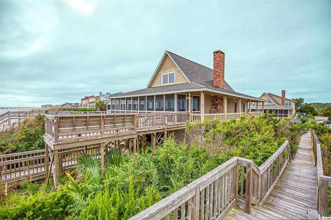 Oceanfront on Pawleys Island, and there's nothing better than that! Enjoy 4 weeks every year in this beautiful oceanfront home. Your weeks will be one in the Spring, one in the Summer, one in Fall and one in the Winter. You'll love being at the beach in every season. This home features a wraparound porch, vaulted ceiling and a wood burning fireplace in the living area, updated kitchen complete with granite counter tops and stainless appliances, hardwood floors throughout and tile floor in bathrooms. Another fantastic feature is a wheelchair ramp for easy accessibility to the first floor.  This is your chance to be at the beach 4 weeks every year!