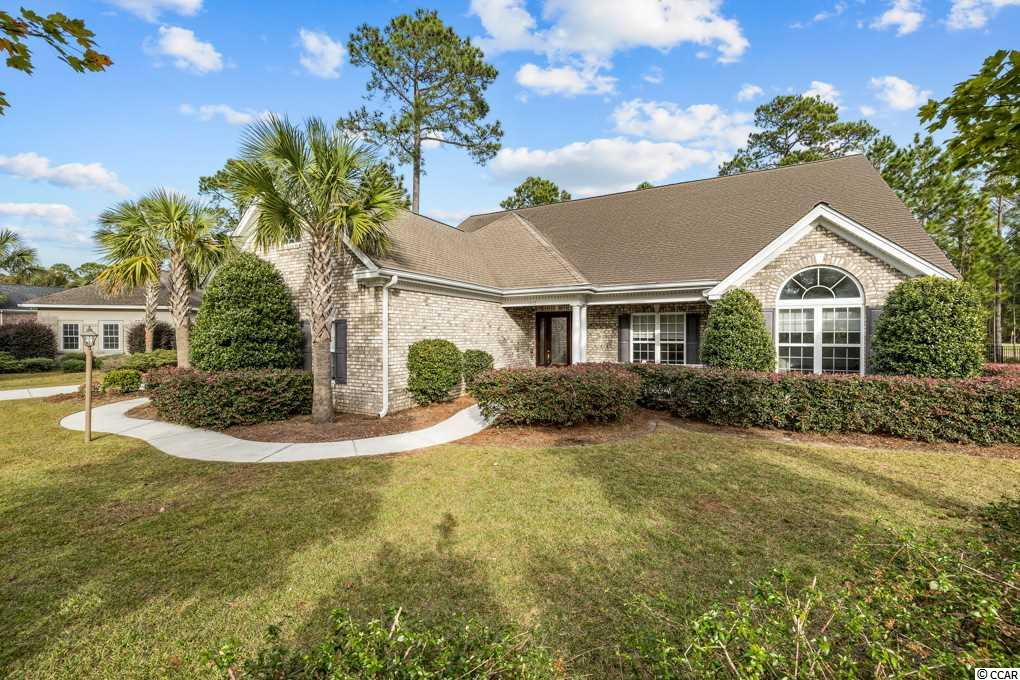 All brick home with one of the best golf course views at Legends Resort makes this home a must see! Situated on a .35 acre lot over looking hole 16 & 17 of the Parkland Course giving this home unique views of this championship golf course! The natural, mature landscaping still offers privacy with plenty of room to add an in-ground pool should you desire. This fantastic, open floor plan offers a beautiful, large eat-in kitchen with custom cabinets, Zodiaq quartz countertops, Large island with cook top, oven and stainless hood vent, ample cabinet space, walk in pantry and a built in desk.  The kitchen is partially open to the dining room which over looks the great room, anchored with built-ins, an oversized fireplace and floor to ceiling windows! The main level is 2462 heated sqr ft., hosting the large master suit, with walk in closet, 2 additional large guest bedrooms and an office that could make the 5th bedroom.  The upstairs has an additional bedroom/loft with a walk in closet and a full bath (440 htd sqr ft) with an additional 480 sqr ft of walk-in attic space for storage. Legends offers 3 award-winning golf courses, a stunning Scottish clubhouse, an Old World pub, a 30-acre lighted practice facility surrounded by estate lots with custom homes. This beautiful neighborhood is centrally located to everything Myrtle Beach has to offer yet tucked away out of the hustle and bustle which leads to quiet, peaceful living. This home will not last long! Call today to view.