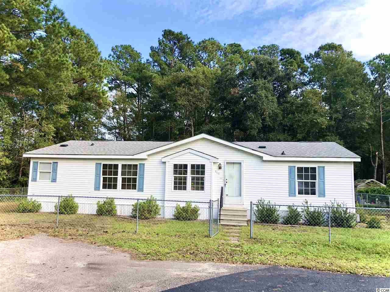 Located close to all Murrells Inlet and the Grand Strand has to offer, this spacious three bedroom two bathroom home located on a cut de sac in the well kept and well sought Coral Bay community of Murrells Inlet is a must see. This home sits on owned land with low monthly HOA.  The interior of the home offers a split floor plan with an abundance of natural lighting, living space, and storage. The kitchen is great for entertaining and for cooking all of your finest cuisines. This home has a large fenced in yard for you furry friends to live their great outdoor dreams as well. Contact your agent or the listing agent to check this home out today!