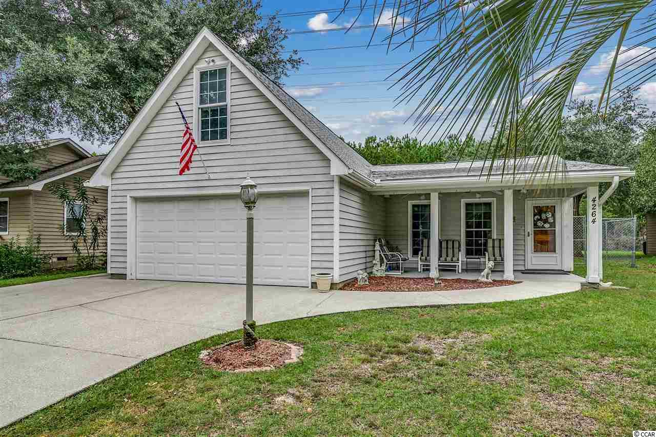 Come live the life that you have always wanted on the Inlet! This one-of-a-kind home is located only a couple of minutes away from the famous Murrells Inlet Marshwalk! Crystal Oaks is a very relaxed community, and the hoa fees are super low! Plus, there is a public boat ramp right down the street, and you can park your boat in your driveway just as long as you keep it covered. If you like to go deep fishing, then this is the perfect place for you! The ocean is easily accessible from the Marsh. Speaking of accessibility, this home has extra-wide doors which make it completely handicapped accessible! This is very rare and hard to find. As you enter through the foyer, you will notice smooth vaulted ceilings and an open floor plan! The main living area features ceramic tile throughout along with lots of room to entertain! The master bedroom is on the 1st floor, and it has laminate flooring along with two huge walk-in closets. The en-suite bath does have a large tile shower as well. There is another bedroom and a full-size bathroom downstairs for guests. The bonus room upstairs was recently added along with the half bath. This area could be used as a home gym, craft room, or mancave! The possibilities are endless! There's also a big storage room up there where you can keep all of your holiday decorations. This home has been very well maintained, and the owner is even offering a home warranty for extra peace of mind. The roof was installed in 2019, and the HVAC system was replaced about 2 years ago! This beautiful home is completely move-in-ready and it is full of Southern charm! The front porch is the best place to relax in your rocking chair while you sip on your favorite drink. The backyard is quite spacious, and it's fenced-in so it's a great place to enjoy time with your furry friends! There is a workshop in the back with electricity so you can use that to work on all your projects. The rear porch is completely screened-in and the yard does back up to the woods so it