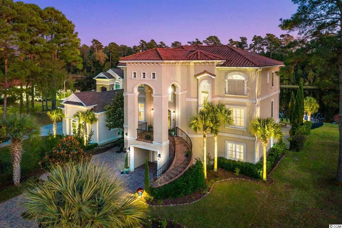 Phenomenal home located on the Intracoastal Waterway in a wonderful gated community.  The home boasts 5,024 heated sq. ft. with three floors of living space.  Ascend the marvelous curved exterior stairs to enter the second level through an impressive foyer.  Just off the foyer is the formal dining room, the open living, kitchen, and breakfast rooms.  Exit out back to an 8' x 36' covered balcony to sit and enjoy the waterway.  This floor also has a laundry room and a large home office with built-in bookcases.  Take the grand staircase to the third level and enter the first bedroom which has a full bathroom and a walk-in closet.  Continue down the hall to the other 2 bedrooms and full bath.  Upon entering the massive master-suite you appreciate a kitchenette, master bedroom with 2 walk-in closets, fireplace, and tray ceiling with rope lighting, and private 8' x 36' balcony.  The master bath has a soaking tub with jets, a large shower, 3 separate sinks and a linen closet. As if a this was not enough, there is another entire level of living spaces on the ground level with a full bath, 2 bedrooms, one of which is currently used as a home gym, and a spacious entertaining space with built-in bar which leads out to a covered balcony with built-in grill.  The ground floor would be the perfect in-law suite as it connects to the rest of the home with the elevator or curved stairs.   There is an oversized 2 car garage.  Once outside, enjoy the in-ground pool with built-in spa as you take in the view of the terraced yard and ICW.  The yard is fenced in and is exquisitely manicured and framed by majestic Italian cypress trees and numerous palm trees, rose bushes, and even two peach trees.