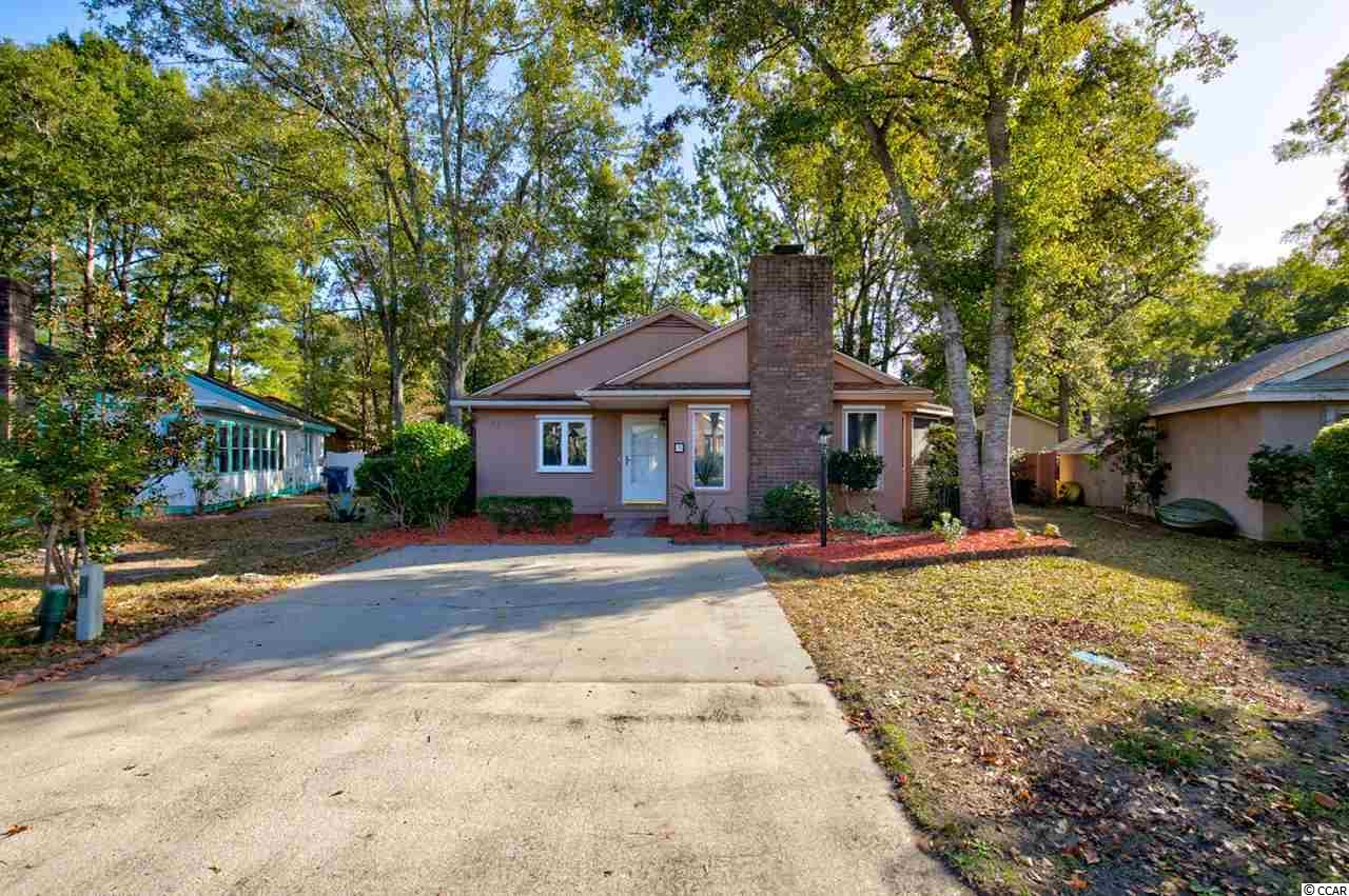 Feel right at home in this Beautiful 3 bedroom 2 bath single-level home with NO HOA, only a few blocks to the beach (golf cart accessible). Beautiful Hardwood floors throughout most of the home. Formal dining room, the living room includes a large brick fireplace, off the living room you have a spacious side porch with privacy that includes french door access to the first bedroom. The large owner's suite has new LVP flooring, a full bath, and a spacious walk-in closet. This home is located in a well-established neighborhood that is close to everything Myrtle Beach offers like shopping, dining, and attractions.  Call us today for your showing!