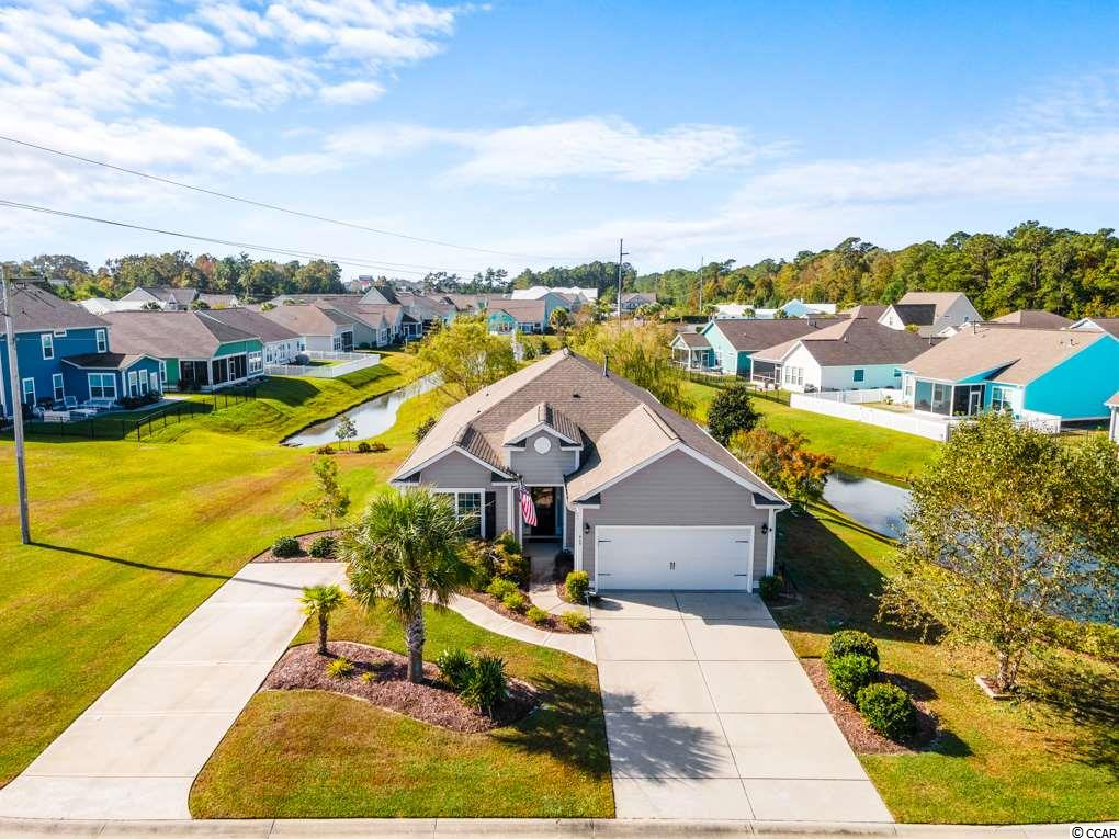 Welcome to the wonderful location of Ocean Walk!! Only a few blocks from the BEACH, Ocean Walk offers lots of amenities including zero entry pool, lazy river, Indoor pool, hot tub, exercise room. This home sets on 1 of 2 lots in the community that is oversized and Private. Perfect for the computer savvy buyer because homeowner wired the home to make it a smart home. This includes Smart Home Video Security Home Surveillance and security system, Smart Home garage Door Opener with Battery Backup. Smart Home Irrigation Controller, Smart Home Motorized Retractable Awning 10 x 20. Smart Home Thermostat, Smart Home Wired For a generator (No generator provided), Smart Home Gas Tankless Hot water heater. Great room with in ceiling surround sound, 30 year Residential Warranty High Gloss Perry Hickory Flooring. Kitchen has granite countertops, tile backsplash, ceramic tile flooring, under counter lighting, Energy Star Black Stainless Steel dishwasher, stove, and microwave. The garage was extended by 4 feet has insulated garage walls and ceilings and a floored attic space. The backyard has 352 square feet of paver patio and many gorgeous Magnolia, Burch, and Japanese Maple trees. New HVAC in 2020. Exterior repainted in 2019. An additional driveway for extra guest parking.