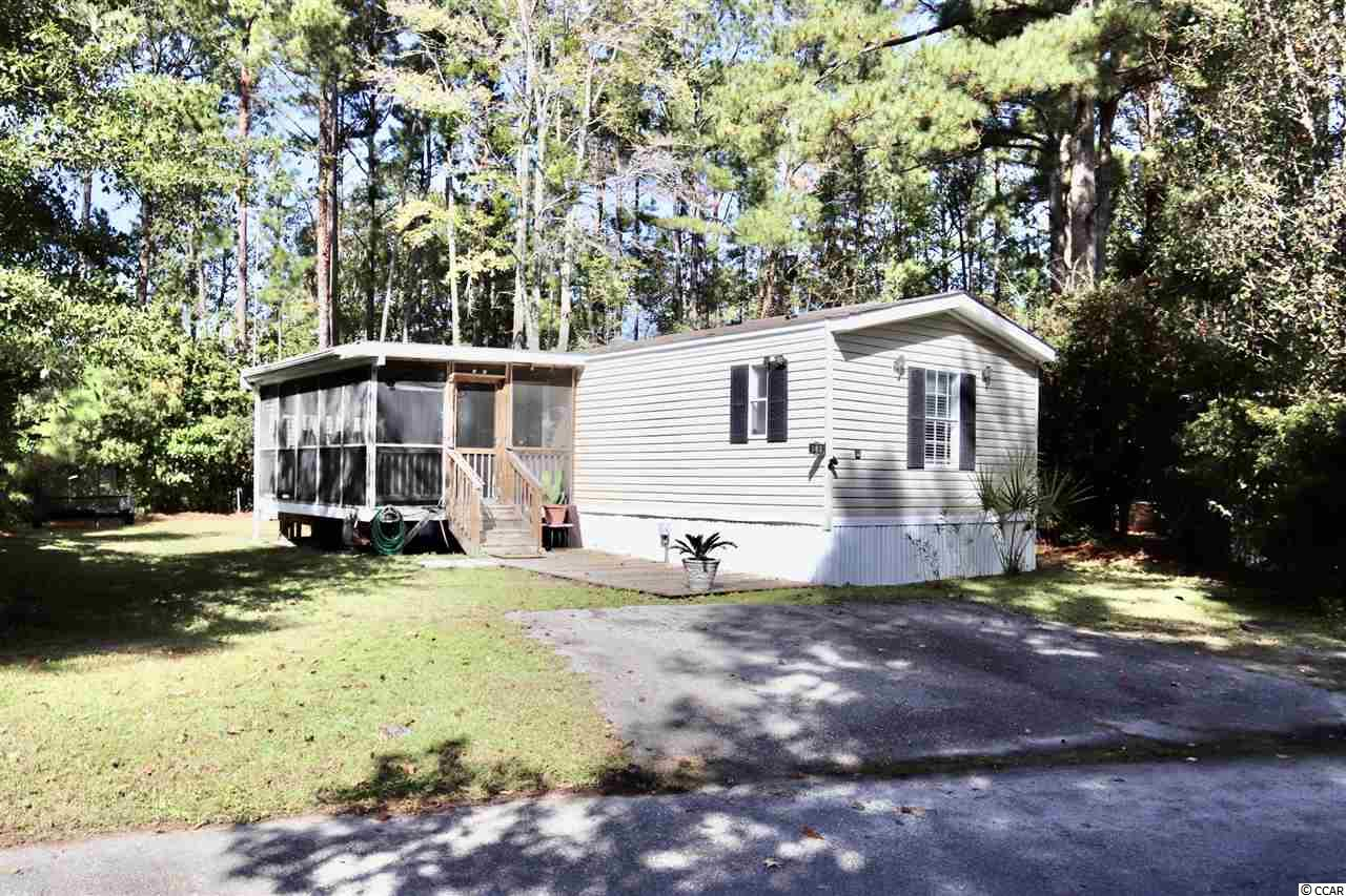 Located in the heart of Garden City, this 3 bedroom and 2 bath home comes furnished and is only a golf cart ride away from the beach. Outside, there is a large 18 X 12 screened-in porch which has 2 ceiling fans and is perfect for enjoying a morning coffee or quiet evening. Inside, the living area and kitchen offer plenty of space which will easily accommodate year-round living. The size-able master bedroom can comfortably fit a king size bed and opens up to a split master bathroom which features 2 separate sinks, a vanity, a garden tub, and a stand-up shower. This home sits on a quiet lot with a mature tree line and offers plenty of shade and privacy. The HVAC outside unit was installed in 2018 and the water heater was installed as recently as May of 2020. Lifeready floors were installed throughout the home at the end of 2018 and are 100% waterproof. This home is move-in ready and comes completely furnished with the exception of the dresser and t.v. in the master bedroom and the glass entry table on the front porch next to the front door. The shed and canopy in the backyard also come with the home. Located just south of Myrtle Beach and Surfside Beach, Garden City is a small beach community known for its friendly atmosphere, water sports, fishing, and crabbing. Windjammer Village is pet friendly, motorcycle friendly, golf cart friendly and offers a clubhouse, community pool, a basketball court, and 3 lakes stocked with fish. This home is located close by to shopping, dining, and many more area attractions including the Garden City Pier which is consistently praised for its live entertainment. Don't miss out on this ideal beach retreat! Schedule a showing today!
