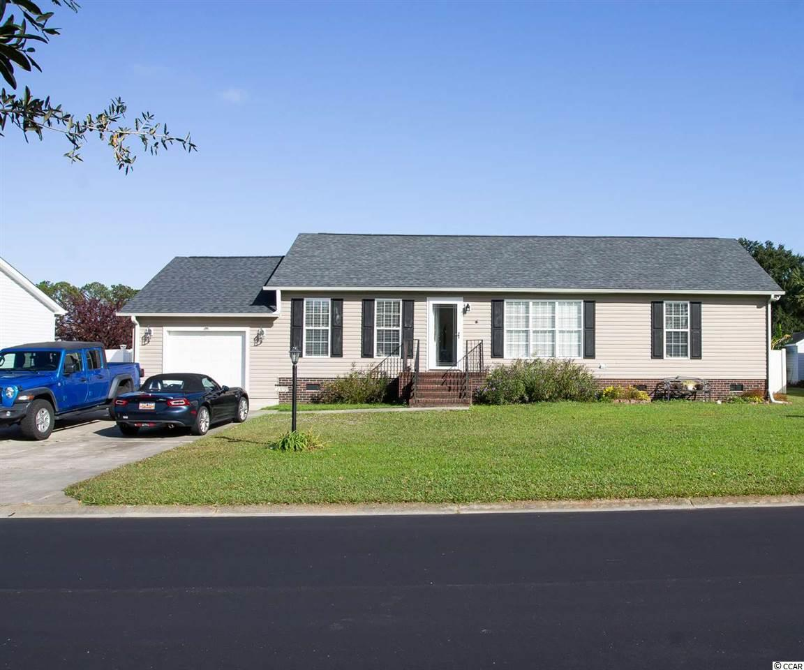 Everything in this great 3 bedroom 2 bathroom home in Murrells Inlet is brand new!  The roof and HVAC were both replaced in 2017.  A single door garage that's deep enough for 2 vehicles or a vehicle and all of your toys was added by the current owners.  The entire kitchen was refinished featuring solid surface counters and stainless steel appliances.  Both bathrooms were redone and both have walk-in showers.  The master bath included both a new tile shower and new whirlpool tub along with a double vanity.  A new deck was added to the back and is perfect for enjoying great views of the pond.  The large, flat backyard is also fenced in.  Hamilton Estates is a great location close to the legendary Marsh Walk and all of Murrells Inlet's finest attractions.  Don't let this home get away!