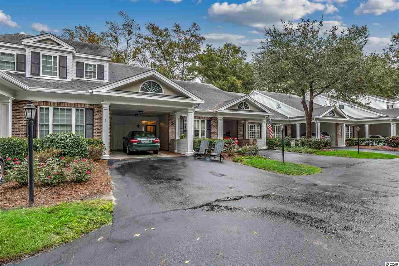 Pride of ownership by the original owner of this 3 bedrooms and 3 full bathroom condo located on the 15th hole of Pawleys Plantation Golf & Country Club, a Jack Nicklaus Signature Golf Course. Two master bedrooms (one on first floor and 2nd upstairs with additional sitting room or office).  Additional bedroom on 2nd floor with it's own bathroom.  Kitchen with stainless steel appliances, corian counter tops, and upgraded cabinets. Plantation shutters and ceiling fans throughout. Dining area, great room, and screened porch overlooks pond and golf course.  Storage areas upstairs and in carport.  Plenty of space for full time or 2nd home living.  Pawleys Plantation is close to area beaches, restaurants, night life, shopping, and other championship golf courses.  Myrtle Beach 25 miles north, Georgetown 8 miles south, and Historic Charleston 70 miles south.  Golf & Country Club information available upon request.
