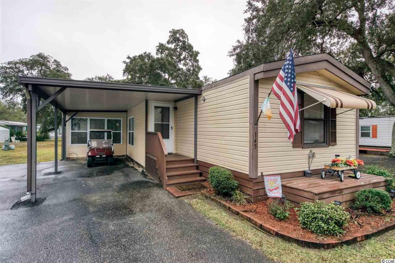 HOT PROPERTY IN A VERY DESIREABLE 55+ COMMUNITY! Amazing 2- or 3-bedroom home with 2 baths, car port and shed (shed has electricity) located at Inlet Oaks Village (55+ community)! The 3rd bedroom can be used as a flex room. This also has a beautiful screened in porch! Furnished and the sale includes a GOLF CART! All this is located in a hospital grid, 16 feet above sea level and X flood zone. Sounds too good to be true but it is true! Don't hesitate if you do you will miss out on a great home! Famous Marsh Walk is only minutes away, along with Brookgreen Gardens & Huntington Beach, Shopping & medical are all minutes away!