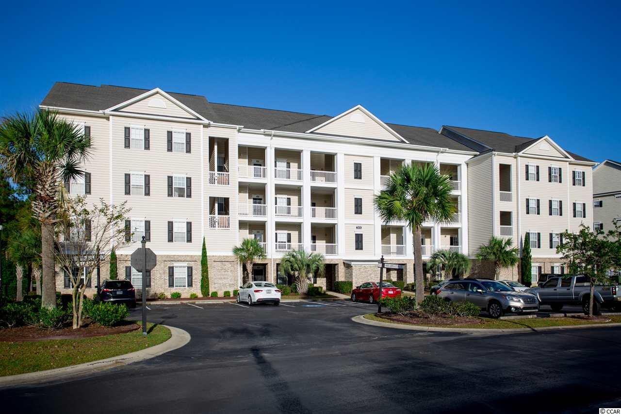 Wonderful views from this lovely 3 bedroom, 2 bath condo located in the gated community of Villas @ International Club in Murrells Inlet.  Overlooking the International Club Golf Course, this move-in ready condo is on the 3rd floor and has a newer HVAC system (2018).  Just take the Elevator to the 3rd floor, step outside and enter the condo into the foyer with crown molding, chair rail and tile floors.  Open floor plan with spacious living room with dining area with carpeting, vaulted ceilings and fan.  Kitchen with white appliances, pantry, extra cabinets, tile and breakfast bar.  Separate laundry room with washer & dryer that convey and storage closet.  Split bedroom plan with large master bedroom with tray ceiling, crown molding, carpeting, fan, walk-in closet and windows overlooking the golf course.  Master bath with tub/shower and crown molding.  There are two good sized guest bedrooms at the front of condo. Both bedrooms have carpet and ceiling fans.  One of the guest bedrooms has a view of the Gazebo and pond with fountain across the street.  The 2nd guest bedroom offers a view of the pool and pond.  2 sliders from the living room lead to the screened in porch overlooking the tree-lined 13th fairway of the International Club Golf Course with lake/pond view.  What a great way to start your day – sipping your favorite beverage and enjoying the peaceful views of the golf course and pond.  The Villas @ International Club is a gated community with walking paths, ponds with fountains, gazebos and a great pool.  Conveniently located, close to Huntington Beach State Park, Brookgreen Gardens, the Murrells Inlet Marsh Walk, dining, shopping, medical facilities and just a short drive to the beach!  You can walk to the International Club Golf Course to take in a quick round of golf or enjoy breakfast or lunch at the clubhouse.  Perfect for a primary home or vacation home, this condo is only a short drive to the beautiful blue Atlantic.  Buyer is responsible for verifying