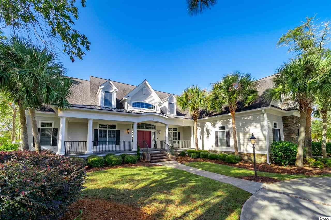 This impeccable lakefront 4 bedroom, 4 and a half bathroom home in the Huntington Mews section of The Reserve has everything a luxury dream home should have! Located in the highly sought-after gated golf and marina community of The Reserve in Pawleys Island, the circular driveway of this home leads you to the front covered porch where you can enter through the foyer to be amazed by the great detail in structure and design placed into this gorgeous home. Living room features include cathedral ceilings, loft overlooking the solid wood floors, custom lighting, wall to wall bookcases, cabinetry and fireplace in the exceptionally spacious open-plan living room. The main living room boasts an excellent lake view through the patio windows and glass doors. The gourmet kitchen has a wealth of storage and cooking space and features a double oven, gas stove and hood vent, wine fridge, Thermidor appliances, custom cabinetry and kitchen work island. The first floor master bedroom suite has a spectacular and well-organized walk-in closet, bathroom with tiled shower, double vanity/sinks and garden tub in addition to its own screened porch through French doors which overlooks the lake. Not to mention, the three car garage and central vacuum system add extra convenience to this already amazing home! Two screened porches, the outdoor fireplace, front porch and back patio of this home guarantees that you will always have an ideal place to enjoy outdoor living anytime of the year! Amenities include 24-hour security, manned entrance gate, tennis courts, trails for walking and jogging, private beach access through the golf cart path and ride to Litchfield by the Sea and all of their amenities, with optional membership to the Members Club, marina and golf course. Membership to the private Reserve Harbor Yacht Club includes access to swimming pool plus dry storage for your boat, wet slips and deep water access for larger boats – all just a short golf cart ride away!  The Reserve Golf Club features a Greg Norman golf course and fine dining.  Close to all amenities that the Pawleys Island area has to offer. Schedule your showing in today - you don't want to miss out on this truly unique custom-built home!