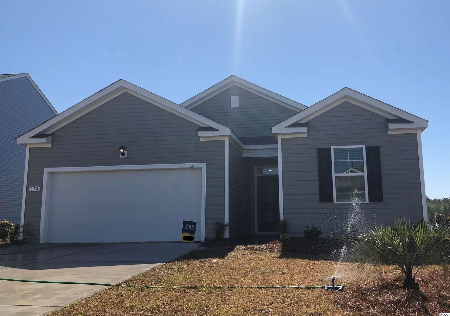 """Oyster Bluff is now selling! Brand new natural gas community just minutes away from shopping, dining, and the beach. Why pay rent? This Macon floorplan offers three bedrooms all on one level. Primary bedroom suite with a big walk-in closet and private bath with dual vanity and 5 ft. shower! Nice, open flow between kitchen and living areas is great for entertaining around the large breakfast bar while low maintenance laminate flooring gives the look of wood with easy care and cleanup! Granite counters in the kitchen, 36"""" white painted cabinetry, stainless Whirlpool appliances, and a great size pantry. Sliding glass doors off the dining area lead to the rear covered porch offering a seamless transition from indoor to outdoor living. It gets better- this is America's Smart Home! Control the thermostat, front door light and lock, and video doorbell from your smartphone or with voice commands to Alexa. Tankless gas water heater and a 2-car garage with garage door opener also included.   *Photos are of a similar Macon home. (Home and community information, including pricing, included features, terms, availability and amenities, are subject to change prior to sale at any time without notice or obligation. Square footages are approximate. Pictures, photographs, colors, features, and sizes are for illustration purposes only and will vary from the homes as built. Equal housing opportunity builder.)"""