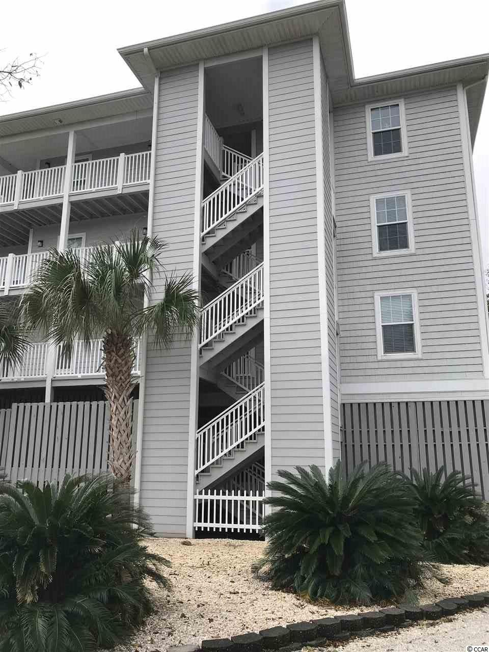 Move in ready 2 bedroom condo in the heart of Surfside Beach. Building is located across the street from the town library, tennis courts, playground, dog park etc. and walking distance to the beach. The unit has beautiful Brazilian Tiger Wood floors, the large master bedroom has dual custom closets, full size washer and dryer in hallway closet. Parking under building for your car and golf cart, additional parking on grounds. Both bathrooms have been redone with beautiful tiled showers. The screened in porch that overlooks the pool also has storage area and there is a common locked storage area under the building for owners. Measurements are not guaranteed and are buyers responsibility to verify.