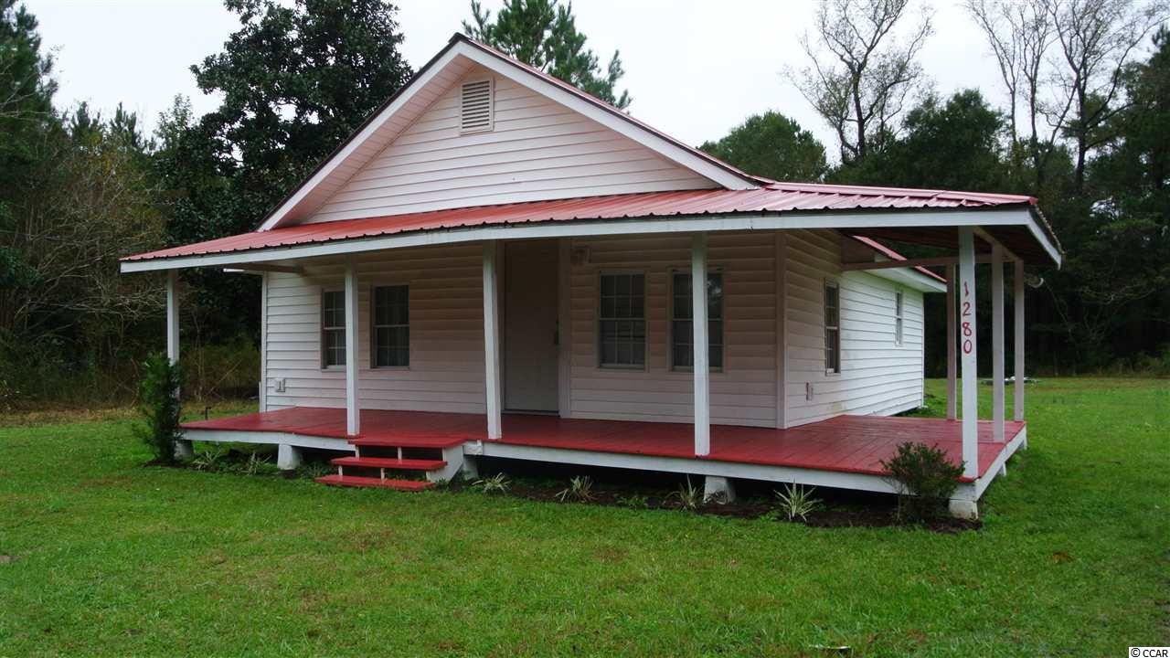 This cozy 2BR/1Bath home is a fixer upper with great potential and is being sold strictly in AS IS condition. Enjoy country living in its finest on a large over a half acre lot in quiet area of Conway. Will not last long!
