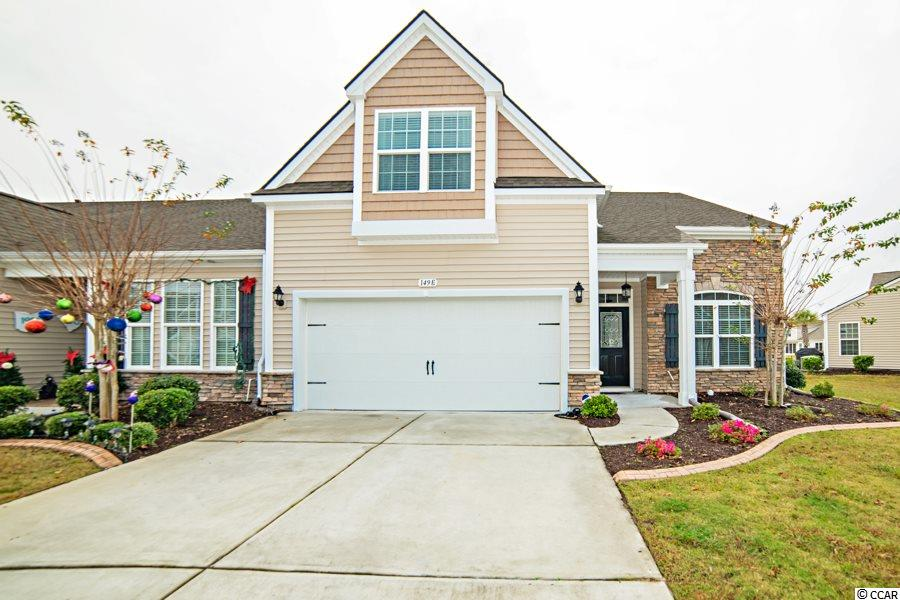 This breath-taking end unit over looks the water in the sought-after community of Parmelee in Murrells Inlet.  Many upgrades throughout this townhome for you to will fall in love with, starting with the kitchen custom tile work, shiplap around the breakfast bar, custom cabinet sliders, granite countertops, gas range and stainless-steel appliances.  In the master suite, large walk in closet that also has a pull-down stair for easy access the to the attic with plenty of storage.  In the spacious master bath, you will find a beautiful custom tile shower.   Master bedroom has French doors that lead you to your peaceful Lanai.   The Lanai has laminate flooring and Easy Breeze vinyl windows installed, so you can enjoy all 4 seasons!   The other upgrades are wood flooring, wainscoting, alarm system, double car garage with built in storage, brand new light fixtures throughout home.  Come check out your oasis not far from the beach!