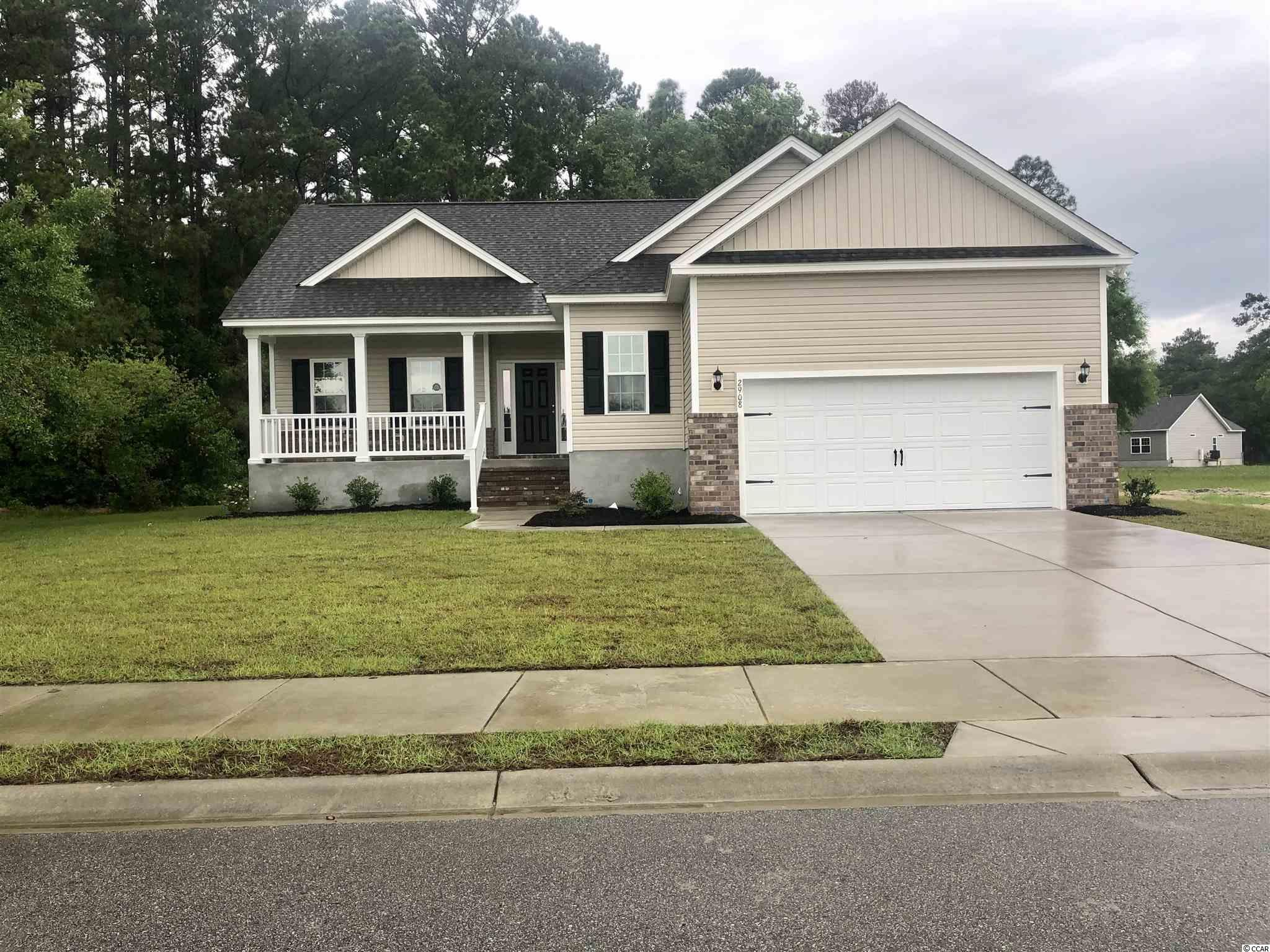 The Dogwood Model is a one level home with 3 BR 2 Bath, 1500+/- heated sq. ft. plus a 2-car garage with an open floor plan that features a spacious and comfortable kitchen overlooking the living room. This home feature includes but are not limited to: Open Kitchen with Large pantry, Stainless Steel Appliances,  5 ft. walk-in shower -  cultured marble vanity top in 2nd bathroom. Pictures are of a similar plan model home and are for illustration purposes only. All of the homes in Harbor Club come standard with the efficiency and luxury of Natural Gas. Enjoy Gas Heat, Natural Gas Range and a Rinnai Tank-less water heater. Beverly homes offers home customization and floor plan changes. Harbor Club is a premier private community located along Winyah Bay and the Intracoastal Waterway, near Historic Georgetown, SC. Community amenities include a day dock, Boat Ramp, Bay House, sidewalks and walking trails that wind throughout the community. A secured RV/ Boat storage area is available for property owners. Huge oaks and beautiful tidal saltwater ponds make this one of the premier communities in the area. Come experience the beautiful and sweet life that the low country of South Carolina and Harbor Club have to offer! Beverly Homes is a equal opportunity Builder.