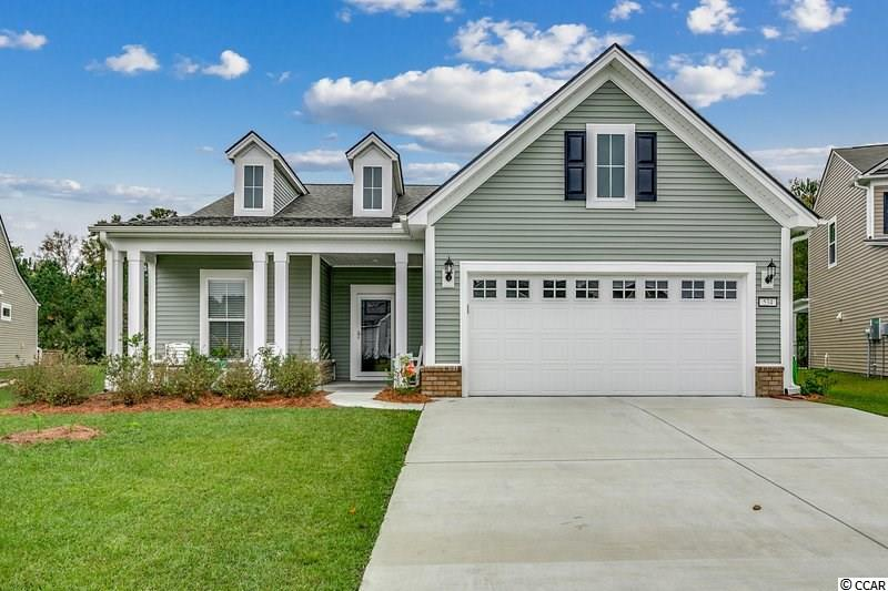 This beautiful, like-new, Pulte built home is a rare find in the Berkshire Forest community!  You'll fall in love with all of the custom features found in your new two bedroom, two bathroom home—craftsman added shiplap, oversized two car garage with service sink, a designated home office space, granite countertops, and a screened in porch—just to name a few.  As you enter your new home, you quickly notice the gorgeous flooring, which is found throughout all of the main living areas. Your new kitchen is every home chef's dream!  The upgraded wall ovens, gas stovetop, and plenty of work space will all allow your family recipes to shine.  The family room has plenty of natural light and has access to your screened-in porch.  This additional outdoor living space means you can enjoy the relaxing sights and sounds of the natural wooded area behind your home every day!  Your luxurious master bedroom has everything you could possibly dream of--an oversized glass shower, double vanity, walk in closet, plus an expansive room size!  Not only will you love your new home, you'll love all of the amenities available to you!  The community pool, Residents Club, basketball and tennis courts, bocce ball, and the Beach Club will definitely keep you, your family, and guests entertained.   This striking home is sure not to last!  Schedule a time to see this unique find in Berkshire Forest today!