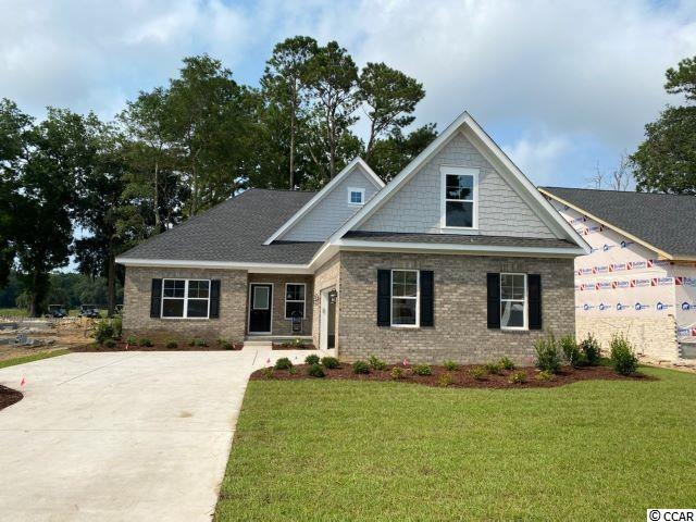 The wait is over for this new phase of Pawleys Plantation. This is a to be built plan with the standard features pricing that is ready for your input on the options and colors.  The home includes granite countertops throughout, 9 foot ceilings, crown molding and tall baseboards, lawn irrigation and much more! All measurements are approximate and can be verified by Buyers Agent/Purchaser. This home is the Beachwood D4 Model. Don't miss this opportunity to own the home of your dreams in Pawleys Plantation!
