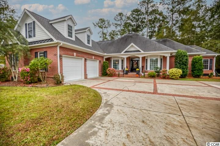 """""""Love at First Sight"""".. Is Home At First Sight!  This charming, meticulously well cared for, all brick home is located in the desirable Collins Creek Landing neighborhood of Murrells Inlet.  Situated on a gorgeous lot with a very private fenced in backyard , perfect for children and pets!  With 4 bedrooms, 3.5 baths this open floor plan is pleasant for everyone.  An impressive family room with a gas log fireplace, and breakfast nook with glass slider doors to patio and a hot tub.  The Carolina Room with cathedral ceilings and glass slider connects you to the patio and private hot tub with a  wall of windows overlooking the backyard.  One of the 4 bedrooms is currently being used as a home office. The guest bath and 1/2 bath were recently remodeled. The master owners suite with tray ceiling offers a spacious walk- in closet and you can access the hot tub outside the master bedroom door. You will love the  large walk-in shower and dual vanities and closets galore throughout the home. A huge kitchen with large island and tons of cabinets overlooking family room. The laundry room with a set tub and built in ironing board makes for a complete area.  Two Rinnai water heaters and New HVAC make this an easy seasonal comfortable experience. The upstairs bedroom/bonus room has its own private bathroom. The  2 car garage with 10' doors has a set tub and built in work bench. The ultimate relaxation on your backyard patio  enjoying all that nature can offer comes with this home.  Collins Creek Landing offers many amenities including clubhouse, playground area, swimming pool, basketball court, soccer field and batting cage, community boat landing and dock. Conveniently located are many restaurants, shopping, golf and miles of of gorgeous ocean beach to explore and enjoy! Call to view this lovely home today and it will be """"Love at first sight"""" !!!"""