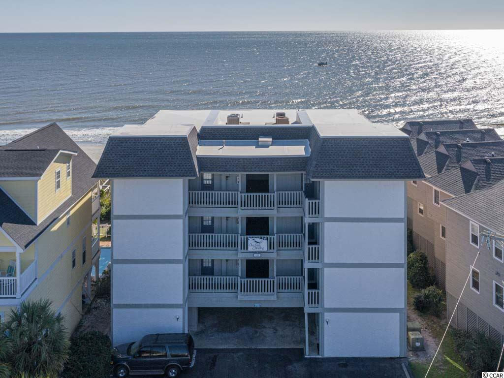 """Completely Renovated Oceanfront Corner Unit in Surfside Beach... """"The Family Beach.""""  Recent Upgrades Include HVAC Installed in 2018, Stainless-Steel Appliances,  LVP Flooring in Living Areas & Carpet in Bedrooms, Vanities, Kitchen Cabinets W/ Recessed Lighting, Kitchen Tile Backsplash, QUARTZ COUNTERTOPS in Kitchen and Bathrooms, New Light Fixtures throughout, and NEW HURRICANE RATED GLASS WINDOWS & SLIDER DOOR Out to Oceanfront Balcony.  Watching The Ever Changing Glistening Atlantic Ocean & Sunrises Will Become Your New Favorite Pastime!  Building Features Include Assigned Parking, Storage Closet on the Ground Level to Put your Beach Chairs and Other Items, ELEVATOR, and OUTDOOR POOL.  This Is Perhaps The Nicest Condo Unit In The Town Of Surfside Beach!  Can Be Short-Term Rented.  All Measurements & Sq. Footage Approximate."""