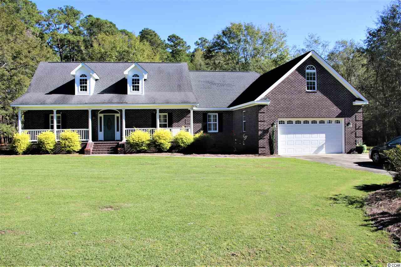 Beautiful all brick home with approximately 2700 + square feet located on a 2-acre lot in Windsor Woods, a quiet cul-de-sac with only 6 homes off Windsor Road. This home has a den with vaulted ceiling and gas logs in the fireplace, 3 bedrooms with a split plan, 2 full baths and 2 half baths, laundry room, kitchen with solid surface countertops, an island and breakfast bar, and beautiful wood cabinets featuring pull-outs shelving and lazy susan in the upper and lower corners. There is dining off the kitchen, plantation shutters throughout the house (even in the bathrooms), beautiful heart pine flooring, and a tiled sunroom. The master bedroom has a vaulted ceiling, 3 walk-in closets, and the adjoining master bathroom has 2 separate vanities, private toilet, a large shower, and a Jacuzzi tub. Upstairs is a carpeted man-cave/bonus room over the garage with a half bath. There is a 2-car garage with storage area, a tankless hot water heater for the house, and a back deck overlooking a wooded back yard. A new HVAC system with a ten year warranty has just been installed. The crawlspace has new automatic vents with a moisture barrier. This home is move-in ready and waiting for you!