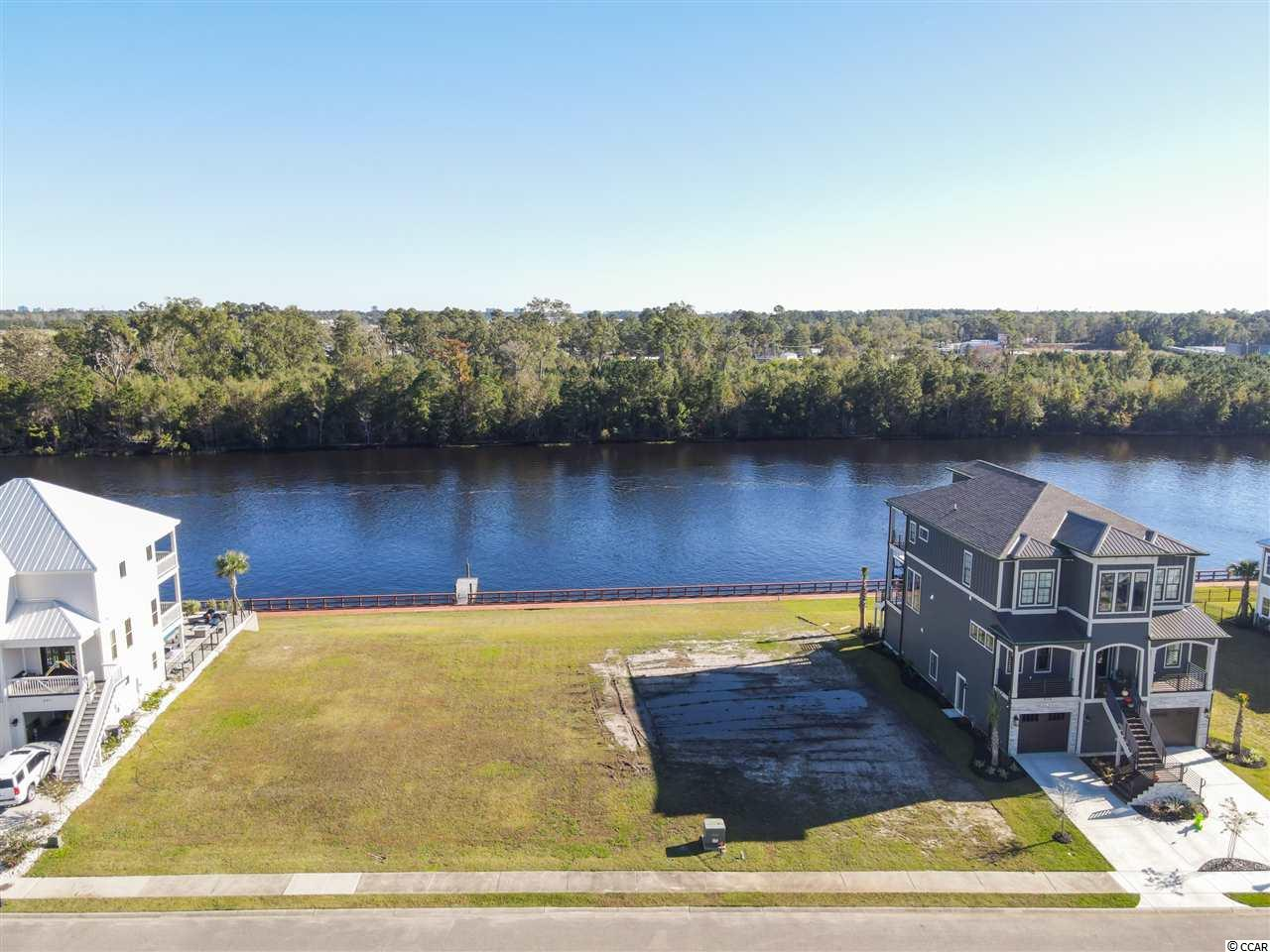 BEST lot for sale in the sought after Waterway Community Boardwalk on the Waterway!. Conveniently located minutes to the airport, beach and all that Myrtle Beach and surrounding areas have to offer. Lot is located at the back of the community out of the flight path and less through traffic. Also located close to the private boat launch and storage area. These lots have been going up in price due to low inventory and priced thousands less than other Intra coastal waterway community lots in the area. Purchase now with no timeframe to build your dream home!