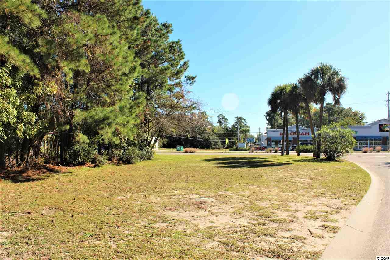 Large corner lot in prime location at the intersection of Highway 17 Business and Misty Breeze Lane across the street from Painters Ice Cream. Only one mile to the ocean, this corner lot is in a high traffic area. Plans on file for 50x24 commercial building. Must see to fully appreciate!