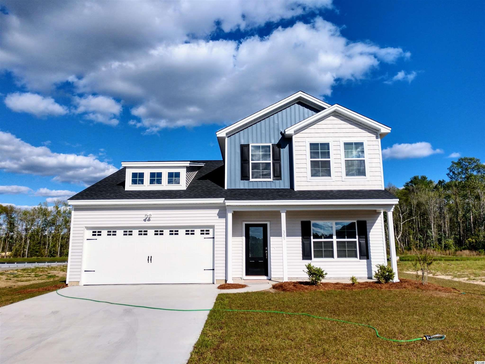 New Community with Pool - Now Selling in Sugarloaf! Just a few minutes from Myrtle Beach and North Myrtle Beach, in Carolina Forest School District, shopping and the beach! This beautiful home will have 2,443 ht sq ft, featuring an open family room/kitchen combo area, 4 bedrooms with the primary bedroom downstairs, Flex Room, Walk-in Attic storage, and a loft. It comes complete with granite and LVP flooring in all the common areas downstairs. All measurements are considered accurate, but buyer to verify. Not the right home? We offer 6 other home plans, from 1,655 to 2,771 Htd SF, 3-6 bedrooms, 2-4 baths. We have the home that will meet your needs! All homes have 2 car garages. Included features: Advanced Framing; Natural Gas! Gas heat; Tank-less gas hot water; Recessed Ceiling lights in Kitchen; Vanity Light in all baths; GE Appliances; Kitchen Granite countertops; Programmable Thermostats; 9' ceilings on first floor; Energy Efficient with LED bulbs, 14-SEER HVAC system, Air Barrier, and Sealing; Architectural Roof Shingles; Vinyl siding with Lifetime Warranty.