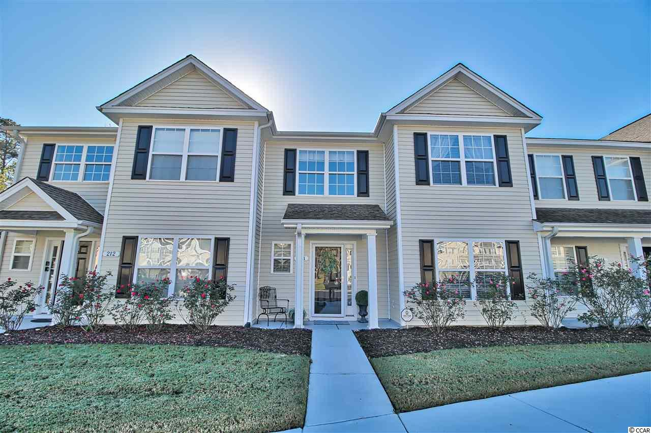 """This move-in ready Townhome is located within the sought after International Club Community in Murrells Inlet. Situated in the """"Glens at International Club"""" this home offers two Master Bedrooms each with its own full Bath, an additional Bedroom and a total of three and one half Baths!  A front porch welcomes you into the tiled two-storied Foyer with double window above allowing for natural light, tiled floor, plant shelves, coat closet and access to the half Bath is here.  The Living and Dining Rooms with new LVT wood flooring flow nicely into each other with a ceiling fan overhead.  The Dining Room features an upgraded lighting fixture and access to the screened Porch through sliding glass doors.  The screened Porch with overhead lighted fan, storage closet and door to concrete Patio, overlooks the private conservation area, imagine sitting there enjoying some peaceful time and listening to nature! Inside the Kitchen, situated off the Dining Room features a Breakfast Bar, double sink and wood cabinetry. Here the Laundry Room is conveniently located with shelving and a window to allow for natural light.  Level One features a carpeted Master Bedroom with Full Master Bath, walk-in closet with under stair storage, an additional closet with shelving and a lighted ceiling fan. The second level finds the additional carpeted Master Bedroom with lighted ceiling fan and two double closets overlooking the woods. The Master Bath features a soaking tub with window, separate shower with glass door, double vanity and private water closet.  The additional carpeted Bedroom with lighted ceiling fan and double closet is also located on this level. The hallway with upgraded lighting fixture, gives access to another full bath conveniently located outside the Bedroom and a little nook for use as a possible reading or computer area. The HVAC system is two years old. Two parking spaces in the front convey with the unit, as defined per a survey. Owners have access to the spacious Amenity C"""