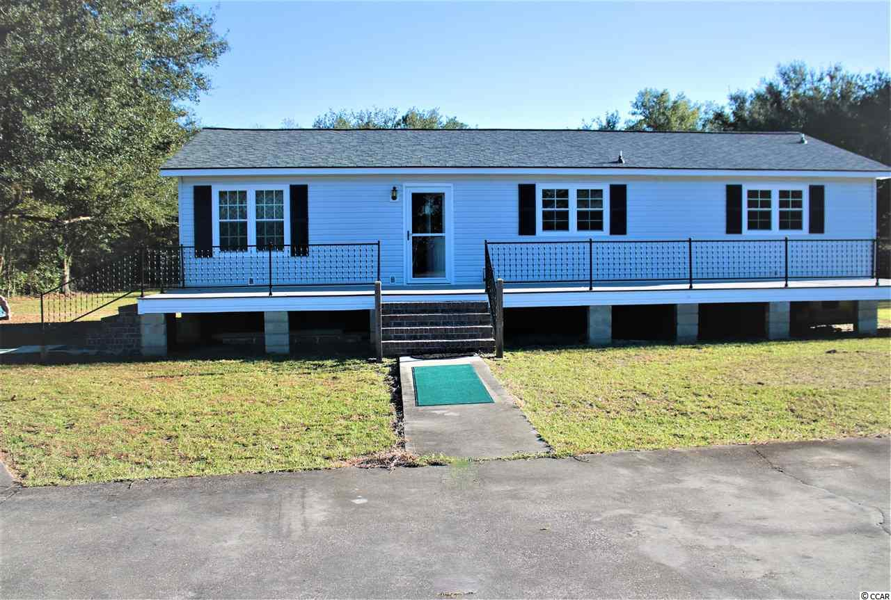 Are you looking for an affordable house outside the city with 3 quarters of an acre of land? Then this is it. This house features 3 bedrooms, 2 baths , large kitchen, laundry room and big great room. This property is just minutes from downtown Georgetown with it's fine dining and great shopping. This one won't last long.