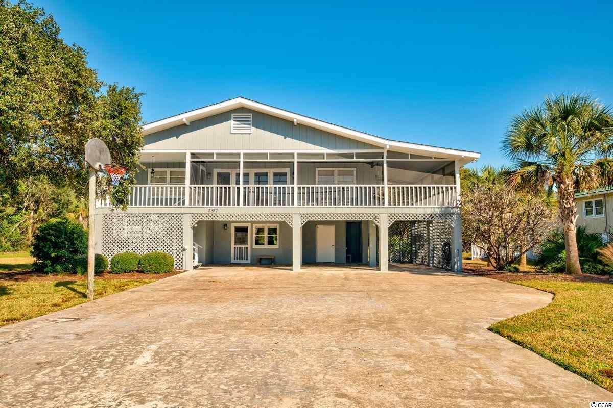 There is timeless appeal in this classic North Litchfield beach home where you are just a few steps away from the beach.  Situated on a nice corner lot, 297 Windover Dr. has been meticulously maintained as a family beach home for years.  Boasting 6 bedrooms, 3 full baths and a large kitchen, this spot is ideal for enjoying long beach days followed by memorable relaxing evenings on the sprawling screened porch (while listening to the waves!).  Bordering Huntington Beach State Park, North Litchfield has long been a family favorite with a wide, healthy beach and good neighbors!