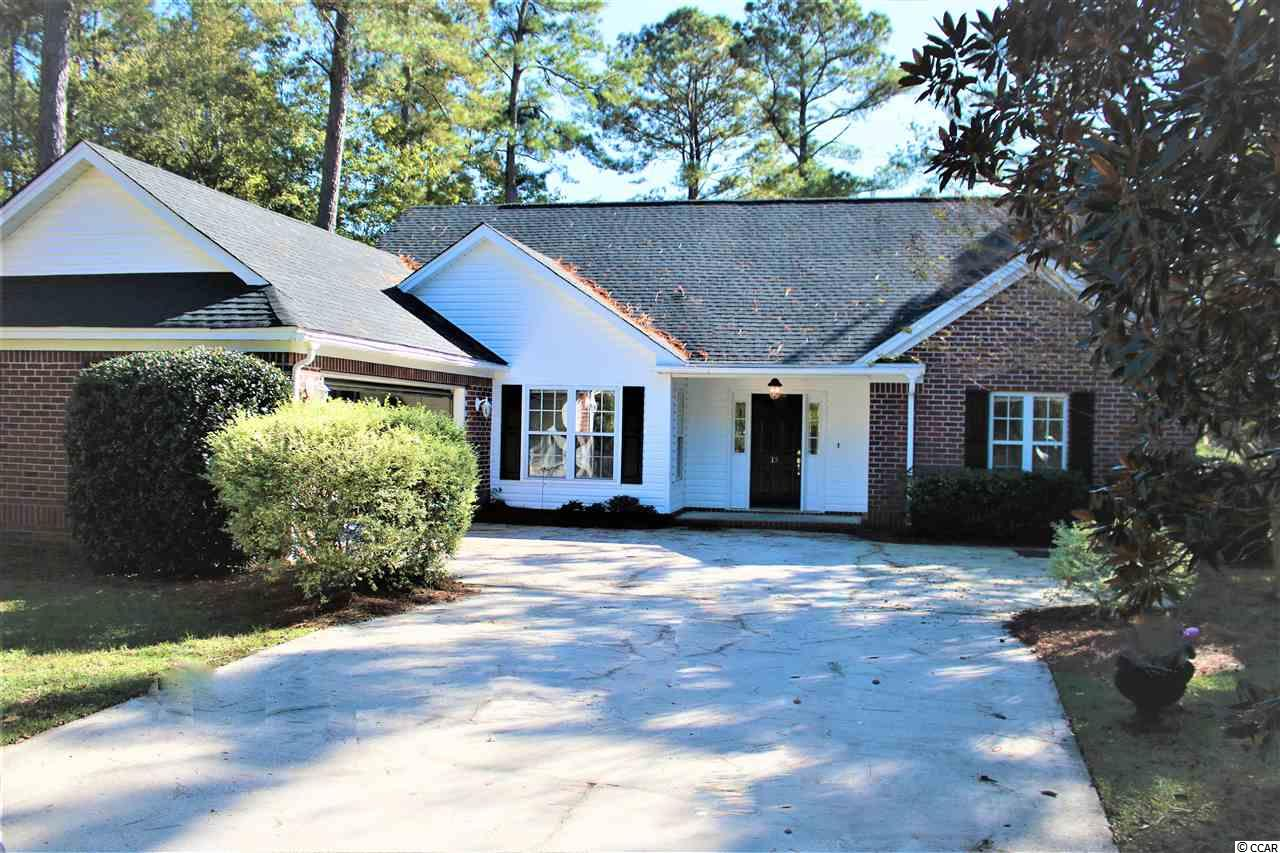 Welcome to this charming 3 bed 2 bath home in the quiet golf course community of Wedgefield Plantation. This home has a side load 2 car garage and sits on a well manicured lot. The interior features an airy split bedroom floor plan with a nice open living room, kitchen, and dining area.  There are laminate floors through out the majority of the home giving it a modern and clean look. You can also take the time to relax in the Carolina room and enjoy the golfers going through and your back yard. Wedgefield also offers a private boat landing and dock into the Black River. From this location you have access to the Atlantic Ocean, and the ICW. Conveniently located near historic downtown Georgetown, with it's fine dining, great shopping and access to five rivers that surround the area an easy drive to Pawleys Island with it's white sand beach. A day trip to Charleston and Myrtle Beach are just a short drive.