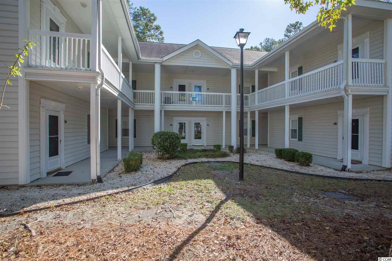 Move-in ready furnished 2 bedroom, 2 bath condo tucked away in the popular Sweetwater community in Murrells Inlet.  Quiet unit on the 2nd floor (top floor) with no neighbors above you.  Just painted with new luxury vinyl plank flooring throughout, this extra large condo is comfortably furnished and features an open floor plan.  This well-maintained end unit has windows on the side bringing in lots of natural light. Spacious living room with dining area, ceiling fan, windows, open kitchen and sliding door to a screened porch with a view of the saltwater pool, lake and private wooded backyard.   Kitchen with white appliances, natural cabinets, refrigerator, range, microwave and island. The split bedroom floor plan creates plenty of privacy for your guests. Master bedroom with ceiling fan and walk-in closet and master bath with walk-in shower.  Good sized guest bedroom with window, ceiling fan and spacious guest bath with shower/tub.  Large, separate laundry room with washer and dryer and extra space that could be used for a small home office, reading nook or hobby/craft room.  The large, screened porch with ceiling fan will be a favorite spot to start your day with your favorite morning beverage or end your day enjoying those delightful evening breezes. New HVAC system (2019), newly painted and new LVP flooring throughout (2020), new bathroom faucets and bathroom light, commodes, storm door (2020).  When you walk into this condo, you will know that you are at the beach. You will want to kick back, relax and enjoy our beautiful beach community! An outside storage room on the walkway outside the condo will be great to store all those extra items! The HOA fee includes water and sewer, cable TV, internet, trash pickup, exterior insurance, exterior maintenance, landscape/lawn, pool service, common grounds maintenance/repair, property manager. Conveniently located just about two miles to the beautiful blue Atlantic and close to shopping, restaurants, endless golf, hospitals