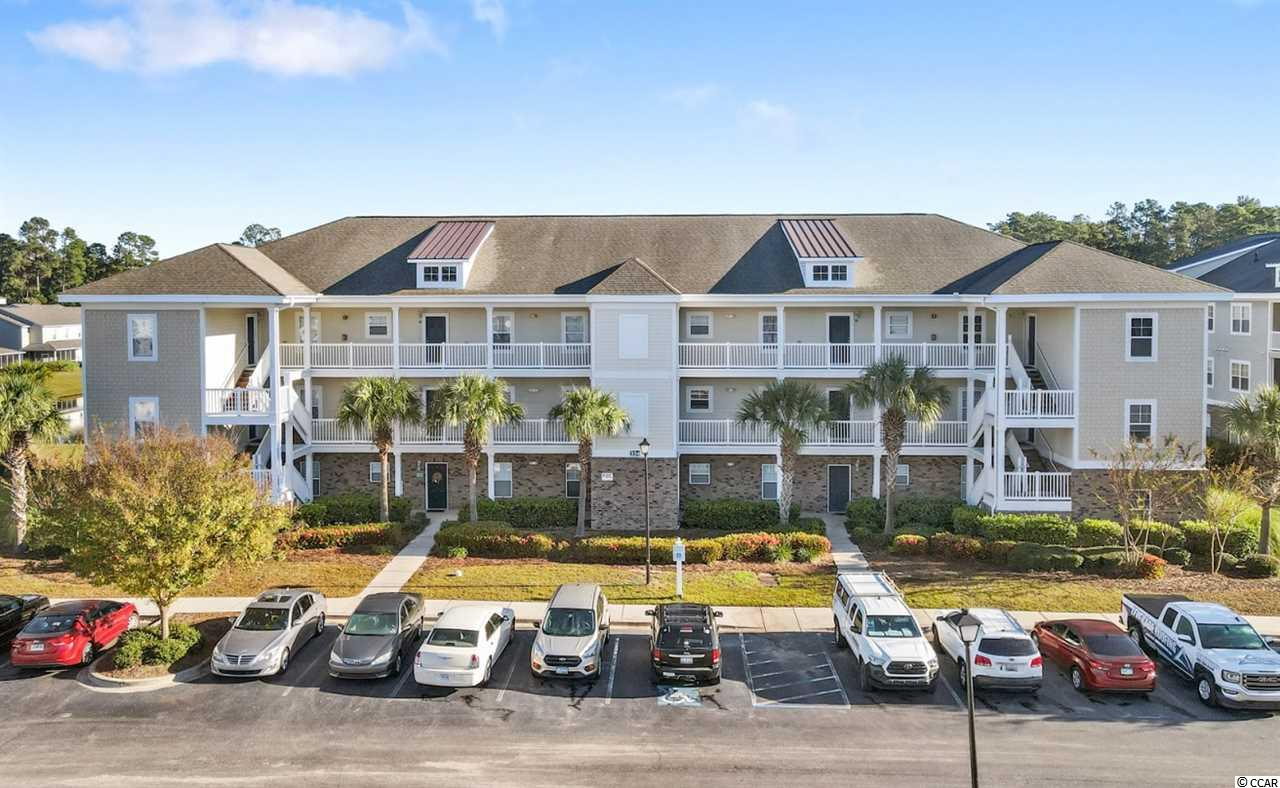 This immaculate first-floor condo is conveniently located in the desirable neighborhood of Kiskadee Parke at Wild Wing. Featuring two bedrooms and two full bathrooms, this fully furnished unit is just a short drive from all Myrtle Beach and the historic downtown Conway has to offer.  As you enter the condo there is ceramic tile throughout the large kitchen, with all appliances included. You'll find a pantry and breakfast bar overlooking the dining area. The open floor plan leads to the furnished living room and to the large screened porch. You can relax and enjoy the view of the pond behind the home.   The master suite has 2 closets including a large walk-in, as well as a full bath. The guest bedroom is on a separate hallway with a full bathroom, providing privacy to guests and owner alike. Kiskadee Parke is close to Coastal Carolina University, the Tanger Outlets, and dining. The community includes a pool, gym, volleyball, tennis, and basketball courts! You'll want to put this home at the top of your list! Square footage is approximate and not guaranteed. Buyers responsible for verification.