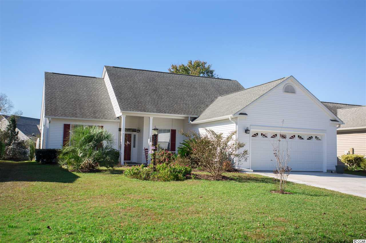 Enjoy the best of Murrells Inlet living in this spacious, well designed, 3 bedroom, 2 bath lovingly maintained home in the popular Indigo Creek community. This lovely, freshly painted home situated on a quiet street with a private backyard with a creek shows like a model with stunning hardwood floors throughout.  Attention to detail and pride of ownership are immediately apparent in this impeccably maintained home.  The stage is set as you drive up to this home with its welcoming low country front porch, red shutters, lushly landscaped lot with pretty flower beds and attractive entry door.  As you enter there is a tiled foyer, adjacent to a large living room and dining area with vaulted ceilings, a large picture and palladium window. The foyer flows into a good sized family room with propane fireplace, vaulted ceiling and fan. This home is spacious with vaulted ceilings throughout, open floor plan and decorative plant shelving. Designed for entertaining with its two living areas, large formal living room and cozy family room, the neutral paint colors will make you feel right at home. Start your day with breakfast in the bright and cheery, spacious eat-in kitchen with granite countertops, new stainless steel appliances (2020), breakfast bar, pantry, plenty of cabinets with pull-outs and counter space and a large bay window overlooking the pretty backyard . Separate laundry room with shelving.  Split bedroom plan with large master bedroom with French doors, vaulted ceiling, ceiling fan, two walk-in closets and four windows bringing in lots of natural light.  French doors from the master bedroom lead into the master bath with high ceilings, new ceramic tile, raised water saver commode, walk-in glass door shower, whirlpool tub, vanity, linen closet, transom window and decorative plant shelving. Two other good size guest bedrooms and guest bath with shower, new ceramic tile and lights and vanity on the other end of the house. A new storm door from the kitchen leads to a patio with a newer pergola. This is sure to be one of your favorite spots to relax, read a good book or start your day with your favorite morning beverage enjoying the sights and sounds of nature including the meandering stream in the lushly landscaped backyard.  This will be the perfect spot for grilling, entertaining and creating happy memories with families and friends.  Oversized 2-car garage with new WIFI garage door opener system, side door and stairs leading to floored storage in attic. Great curb appeal with pretty flower gardens, irrigation system, patio and private backyard. Newer roof (2014), HVAC (2019), new driveway with extra parking pad (2020) and other features including newer gutters, raised commodes, Conveniently located just minutes from the beach, golf courses, hospital, marina, restaurants and shopping.  Community pool and bocce ball court.  The location, serenity and peaceful setting of this home make it one you do not want to miss.  Truly a beautiful home!  Make an appointment to see, you will not be disappointed. Measurements & square footage are approximate & not guaranteed. Buyer is responsible for verification.